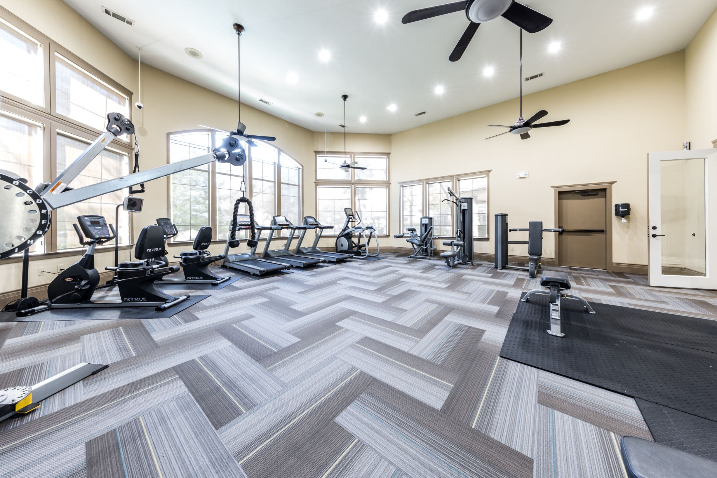 Spacious fitness center with fans at The Marquis at Brushy Creek in Austin, Texas