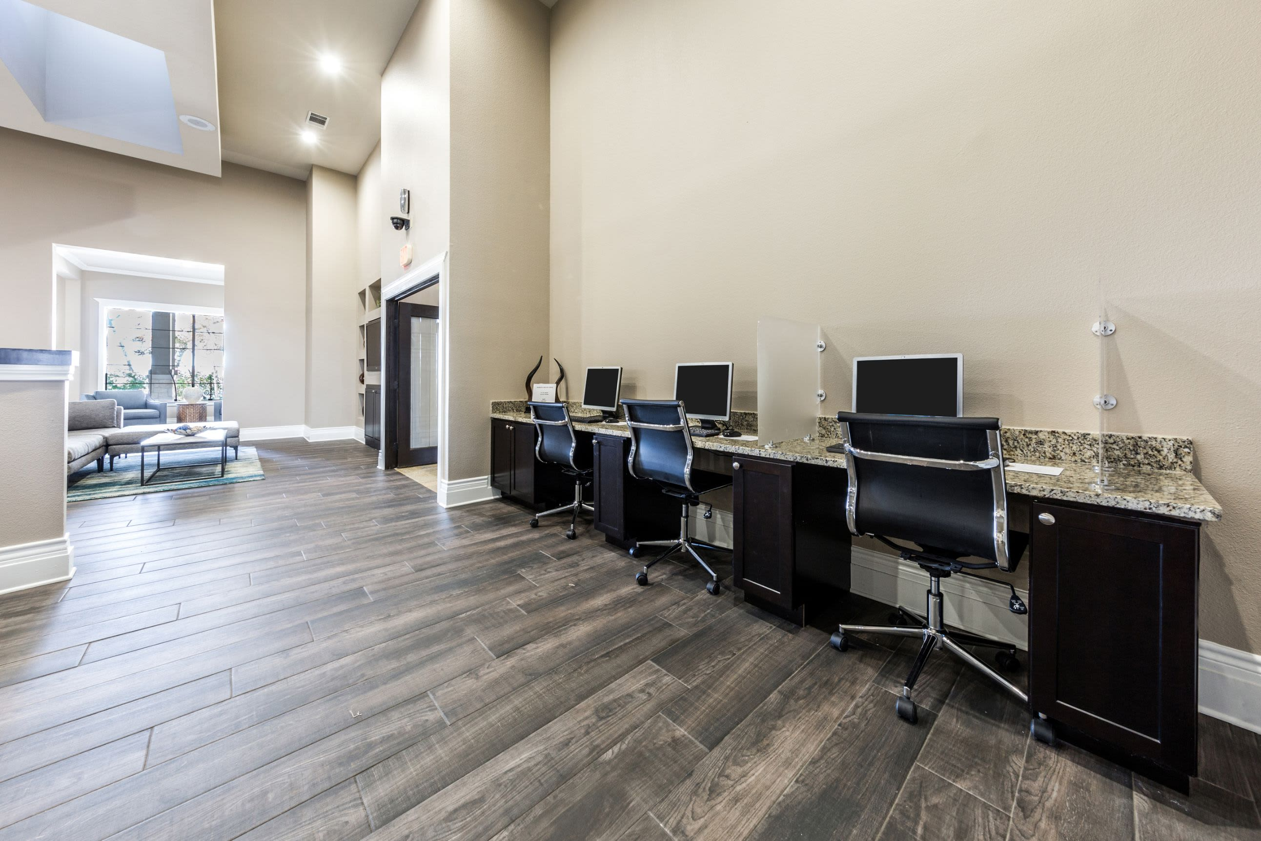 Business center with computers and office chairs at The Marquis at Brushy Creek in Austin, Texas