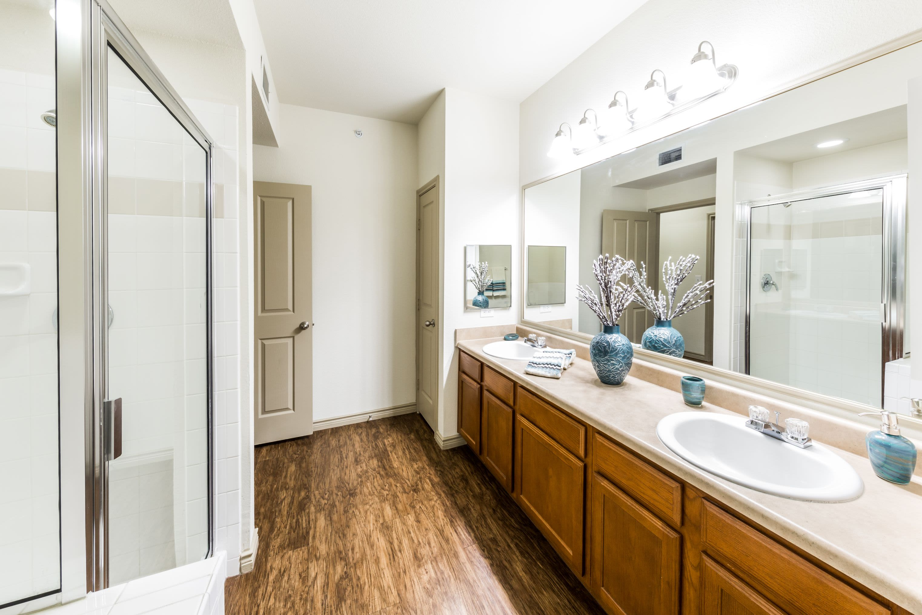 Bathroom with double sinks and a large mirror at The Marquis at Brushy Creek in Austin, Texas