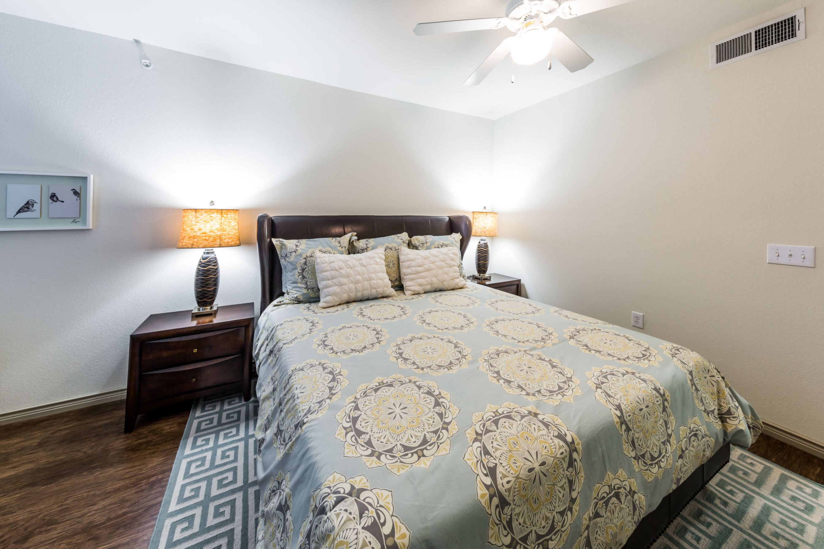 Bright bedroom with a rug under the bed at The Marquis at Brushy Creek in Austin, Texas