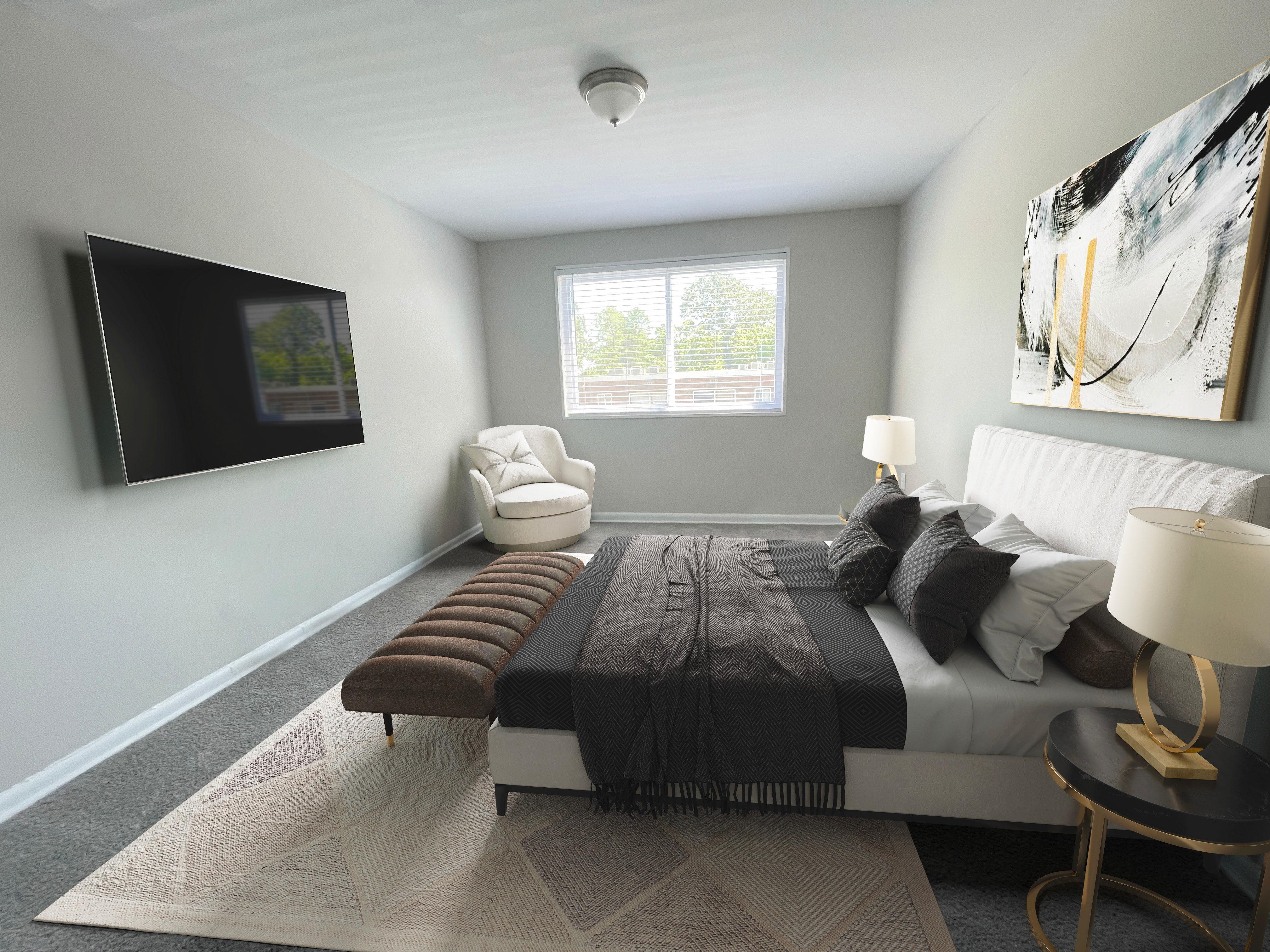 Bedroom shoot with TV in Regency Pointe