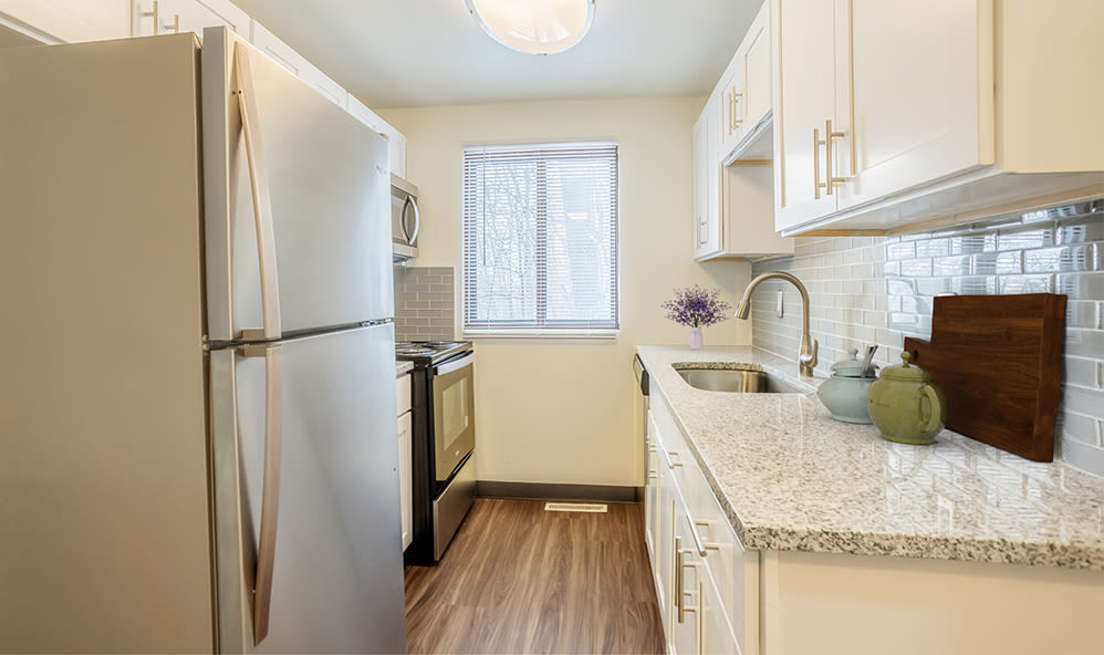Galley kitchen at High Acres Apartments & Townhomes in Syracuse, New York