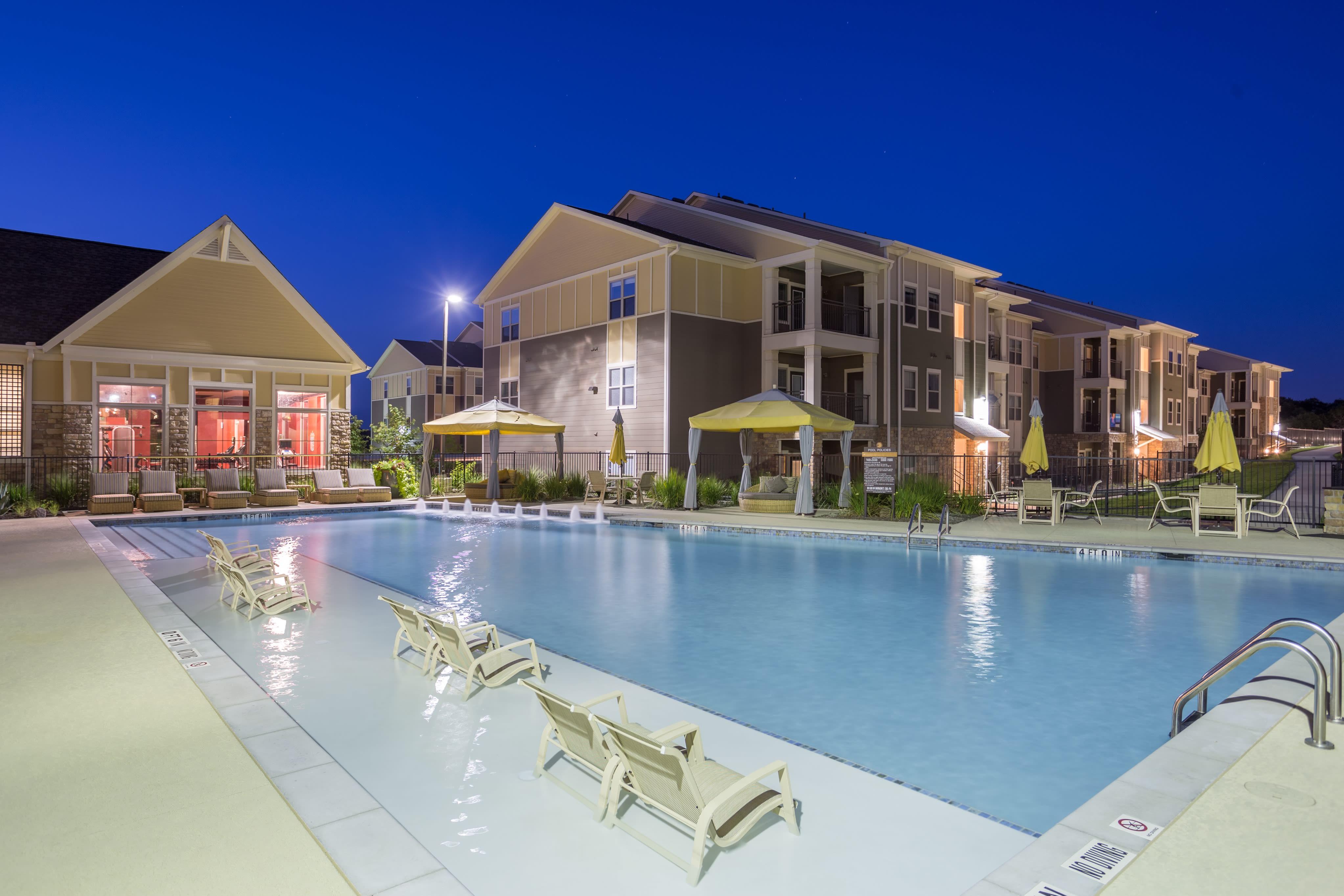 Night view of the pool at Encore 281 in San Antonio, Texas