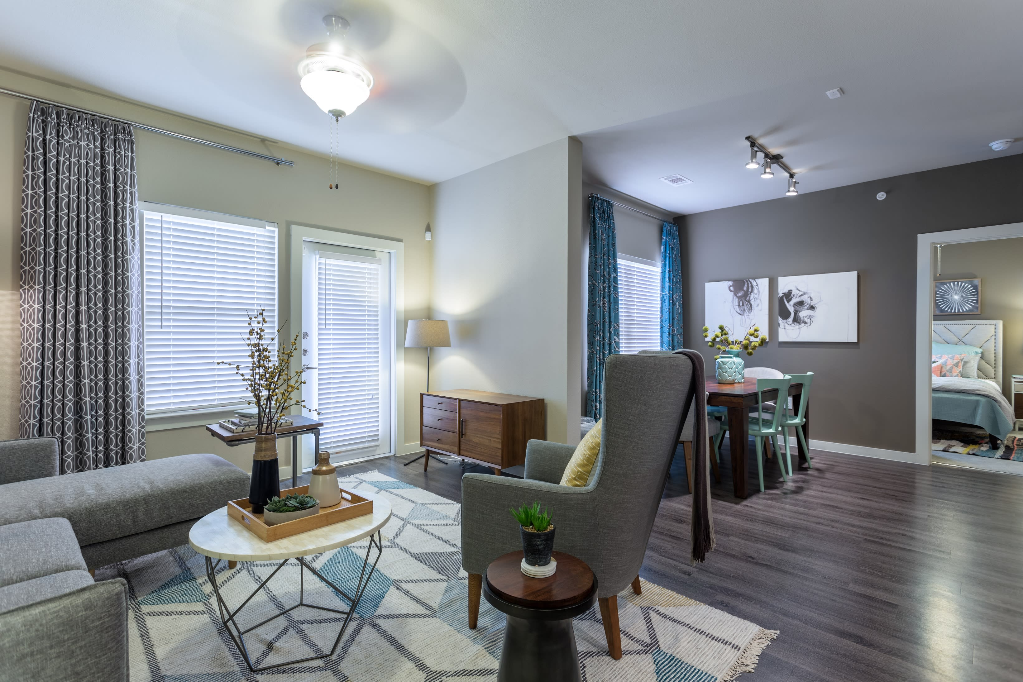 Spacious living room inside one of the apartments at Encore 281 in San Antonio, Texas