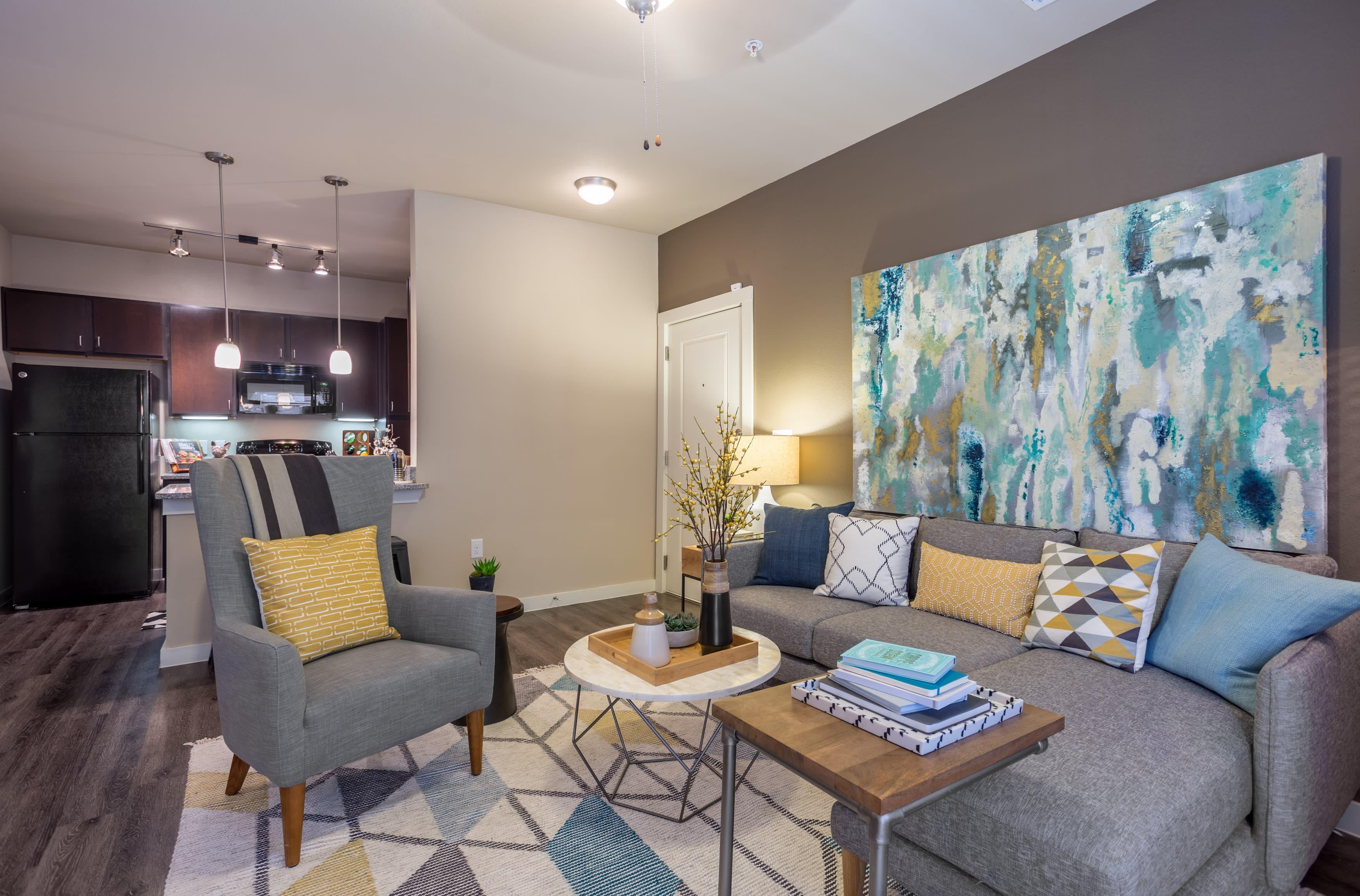 Comfortable living room sitting area at Encore 281 in San Antonio, Texas