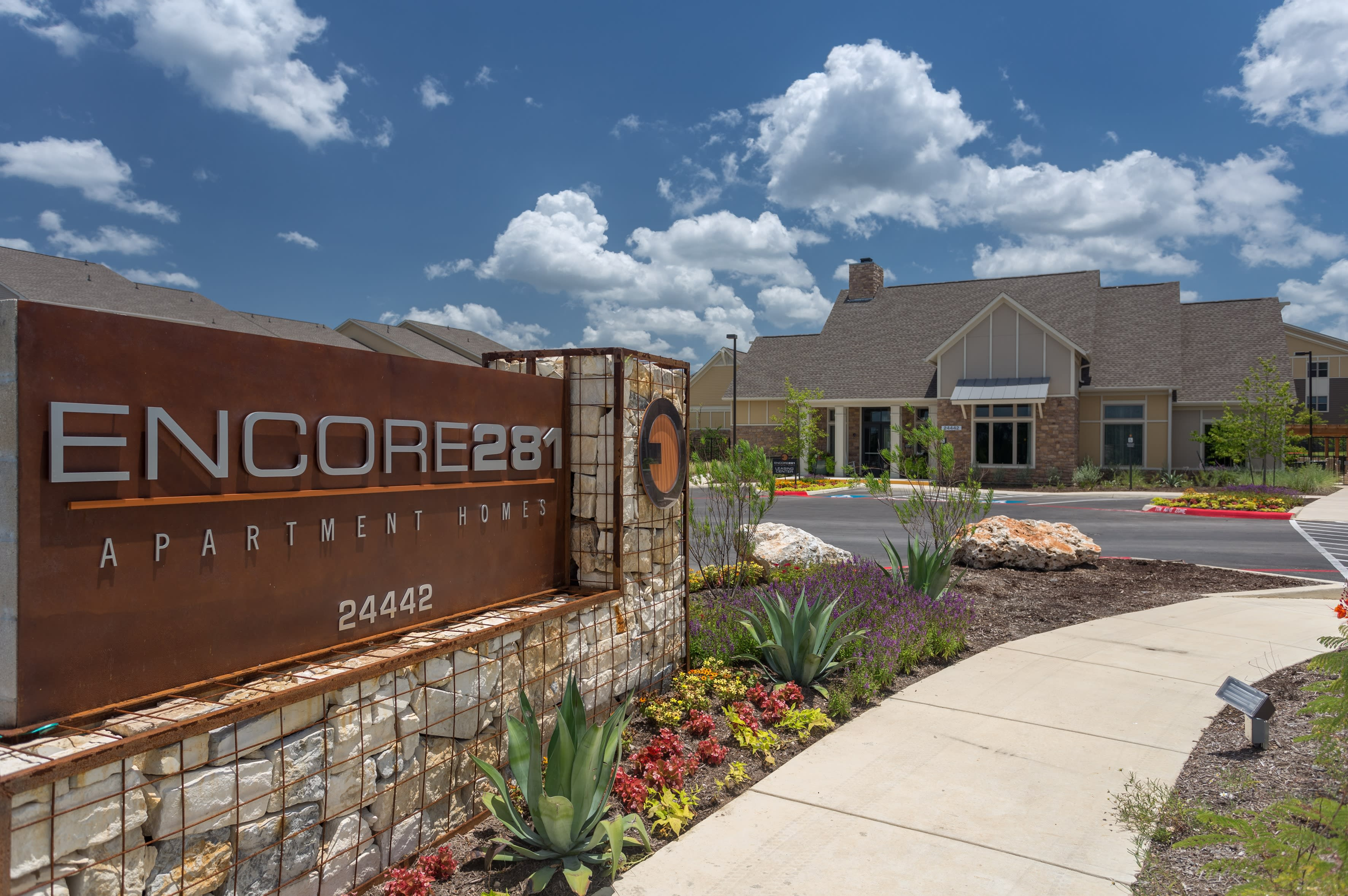 Exterior view with monument sign at Encore 281 in San Antonio, Texas