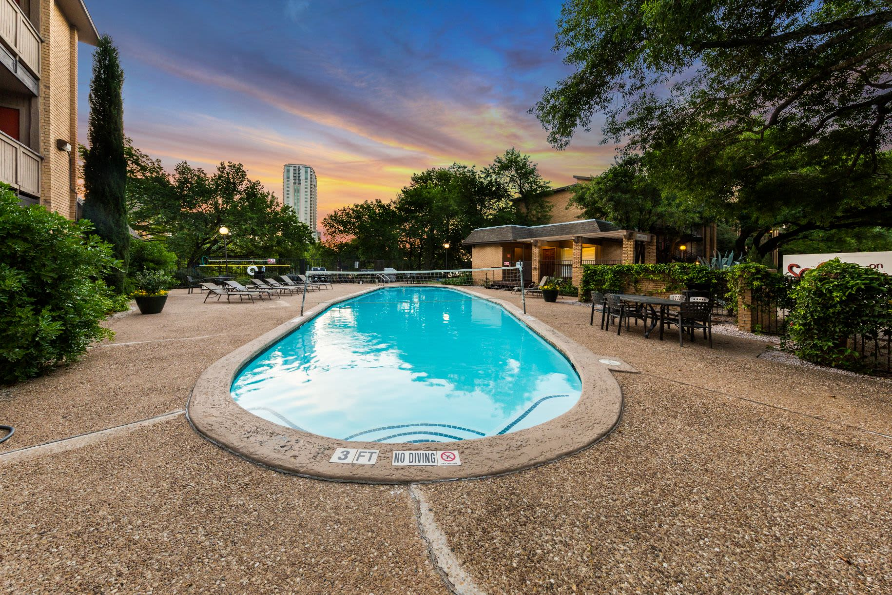 Community pool at sunset at SoCo on The Lake in Austin, Texas