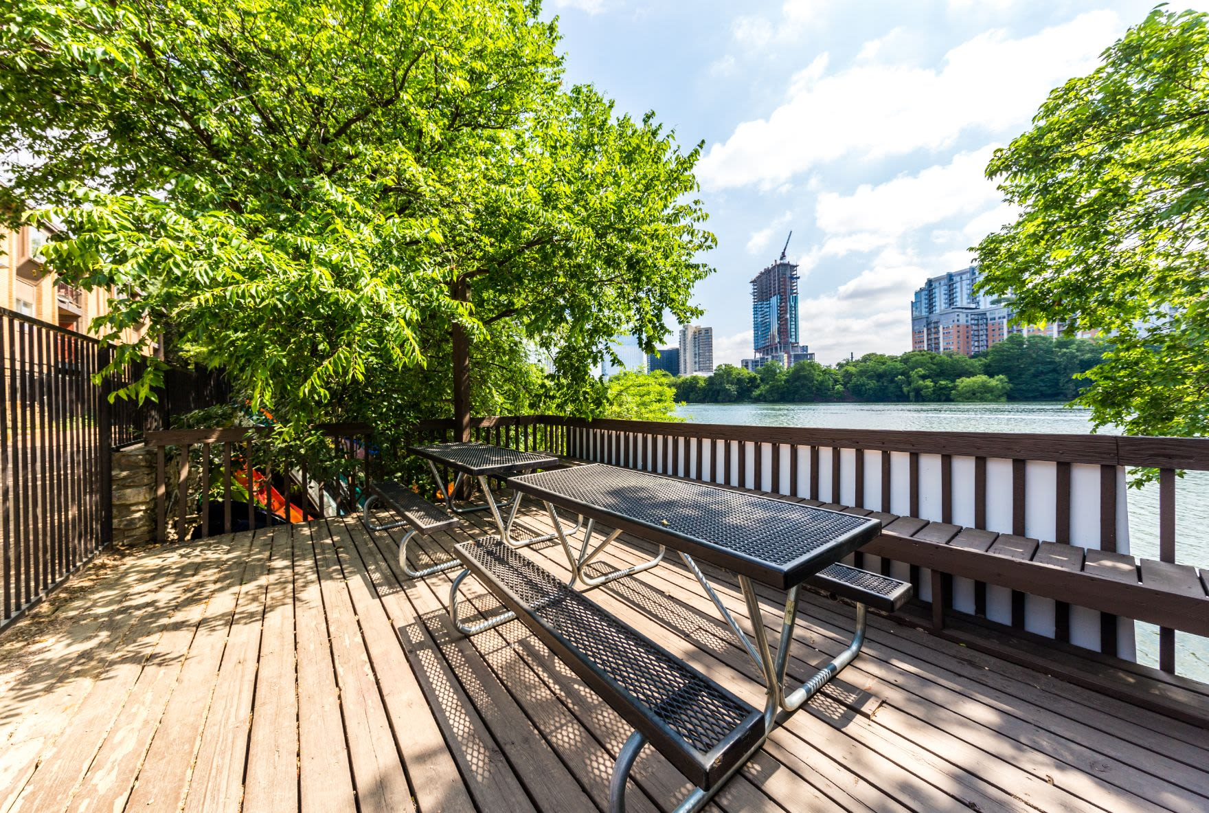 Picnic tables with city views at SoCo on The Lake in Austin, Texas