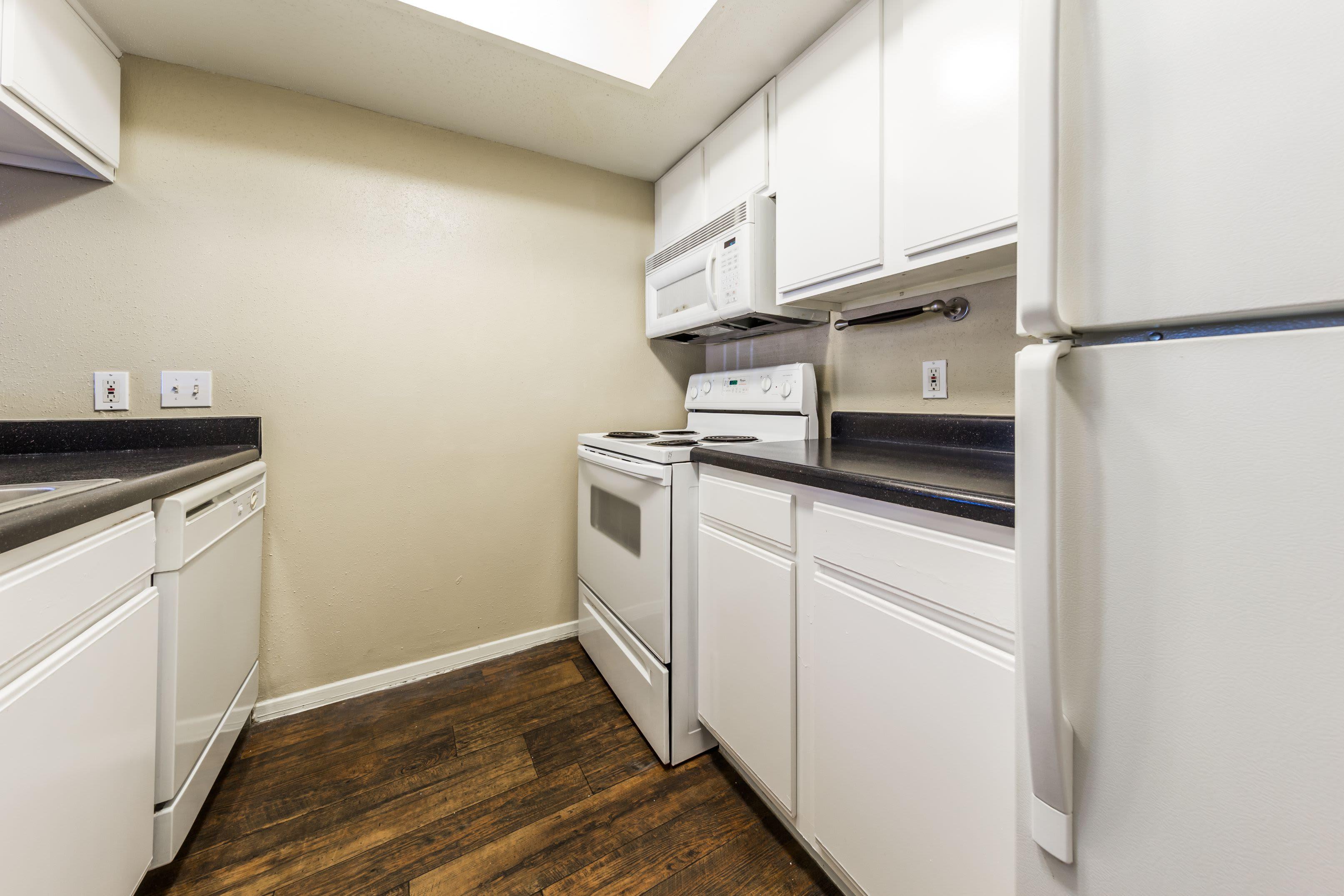 Kitchen with white appliances at SoCo on The Lake in Austin, Texas
