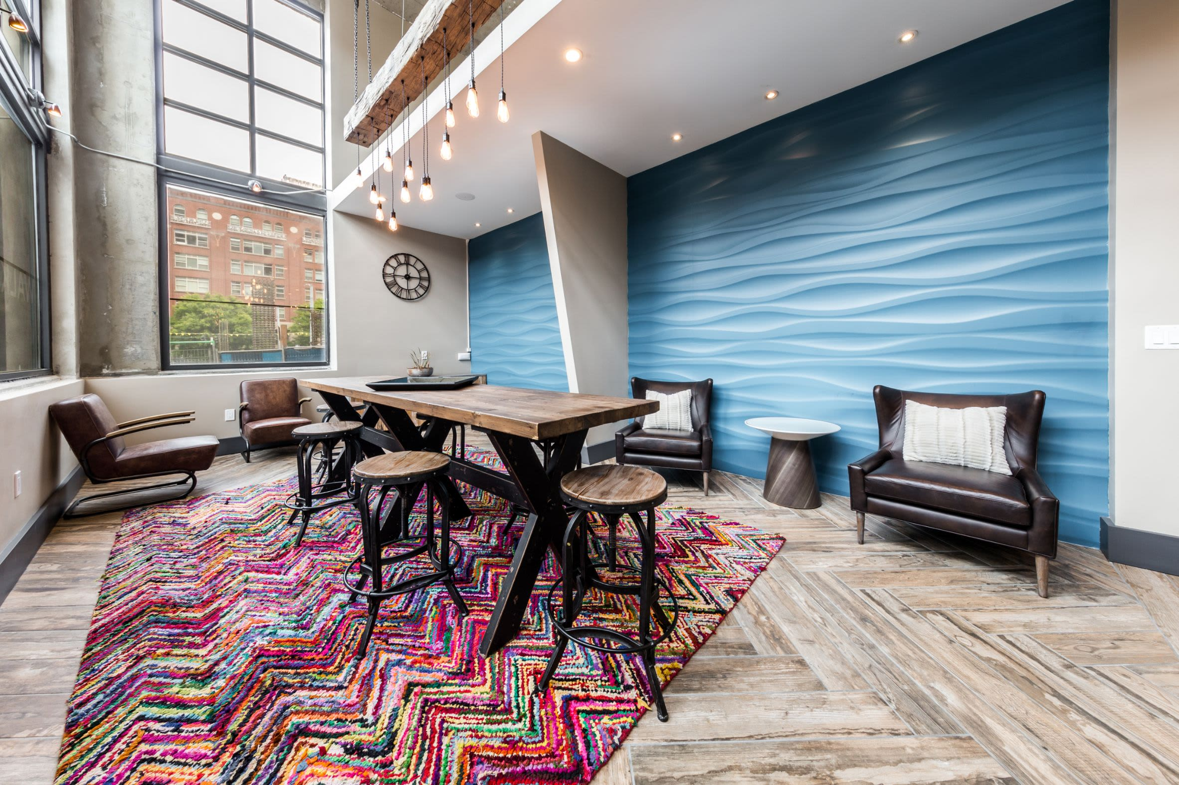 Table and chairs in lobby at Marq 211 in Seattle, Washington
