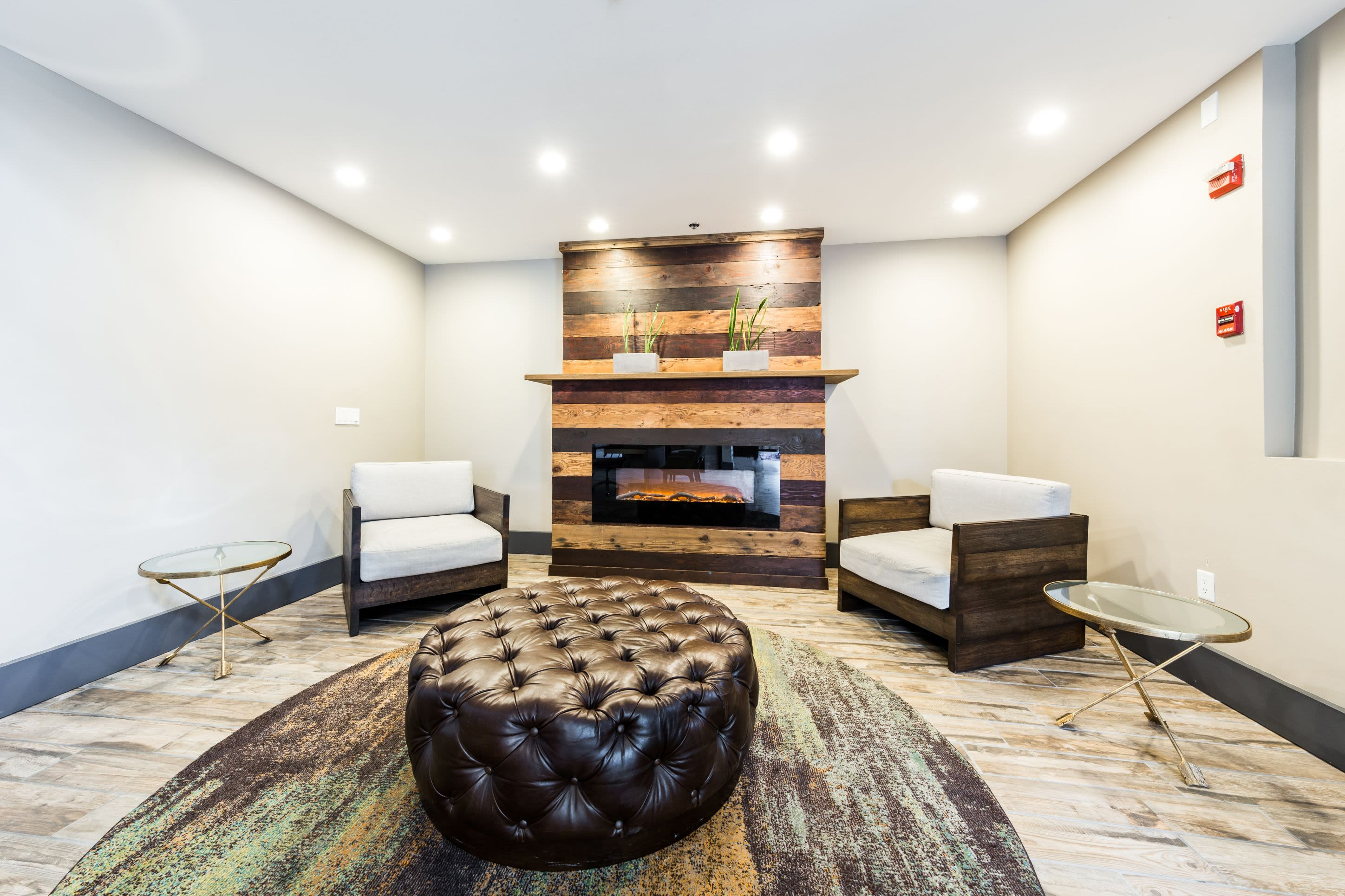Indoor lounge with fireplace at Marq 211 in Seattle, Washington