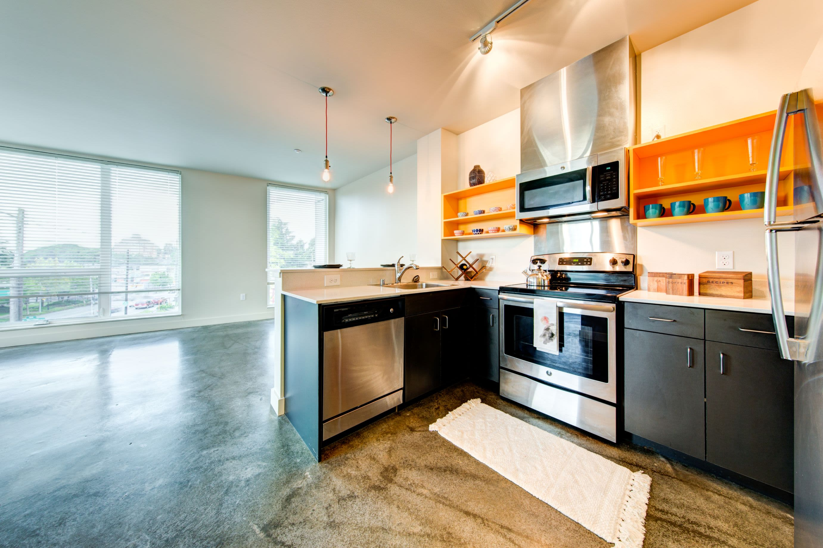 Modern kitchen with black cabinets at Anthem on 12th in Seattle, Washington