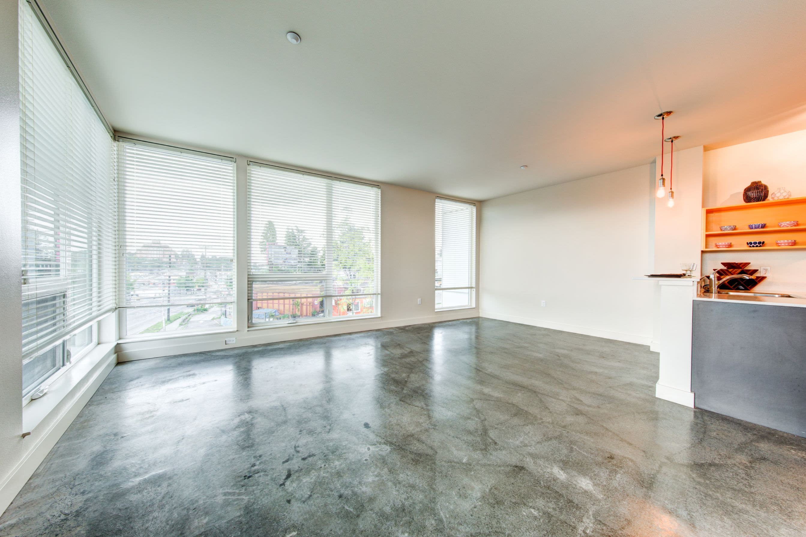 Bright living room with massive floor to ceiling windows at Anthem on 12th in Seattle, Washington