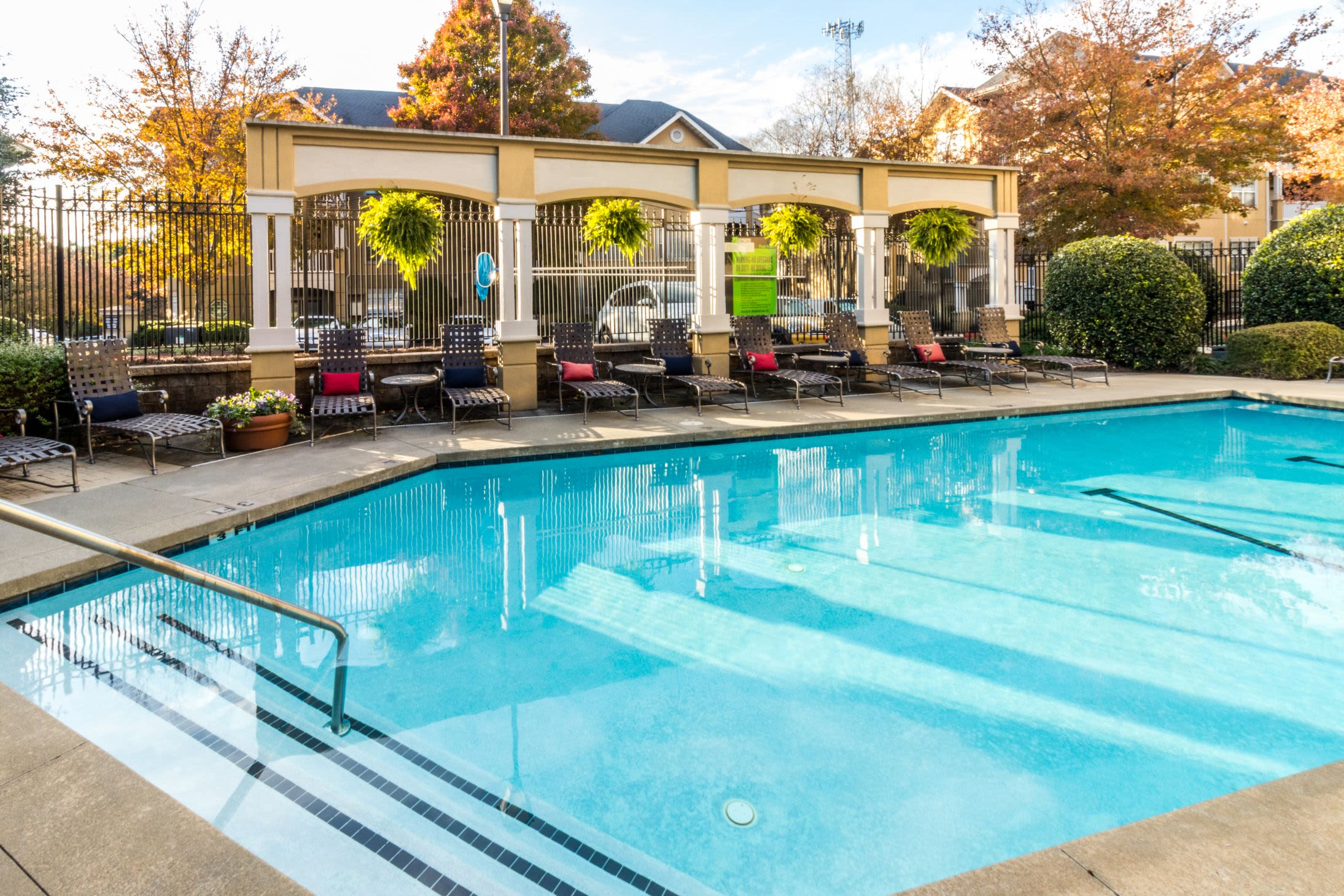 Community pool with sun chairs on deck at Marquis Midtown West in Atlanta, Georgia