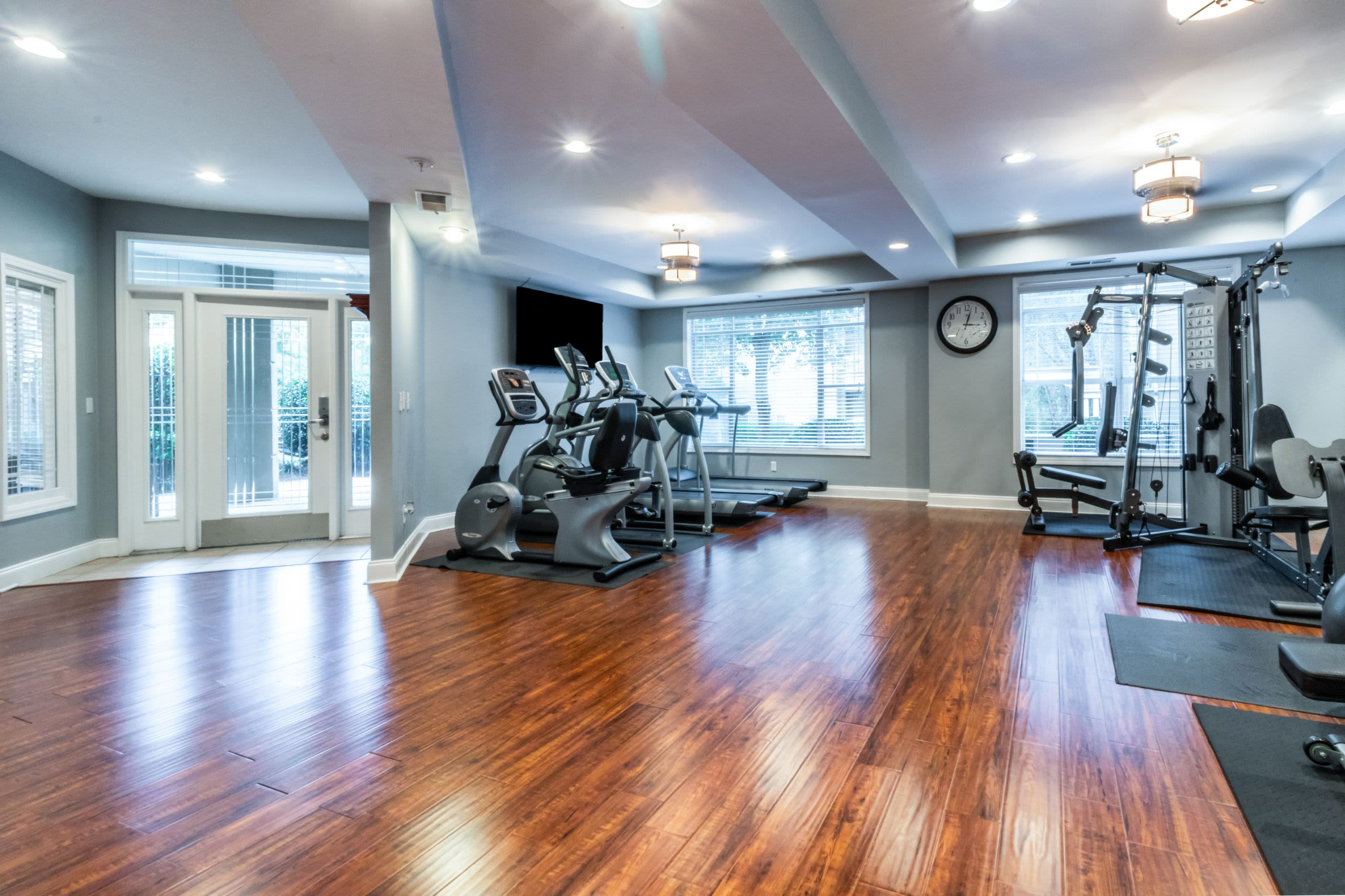 Bright fitness center with wood floors at Marquis Midtown West in Atlanta, Georgia-
