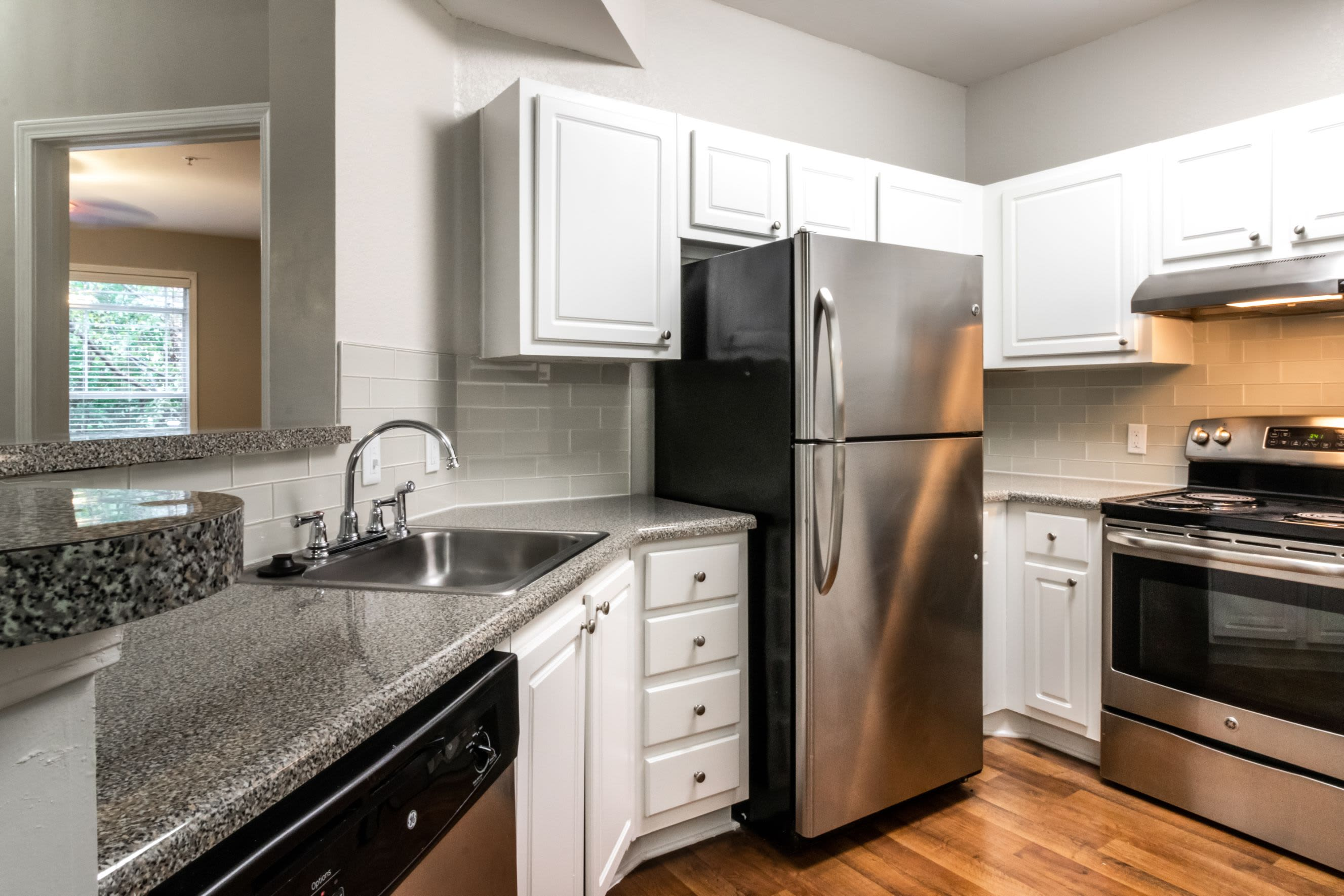 Modern kitchen with stainless steel appliances at Marquis Midtown West in Atlanta, Georgia