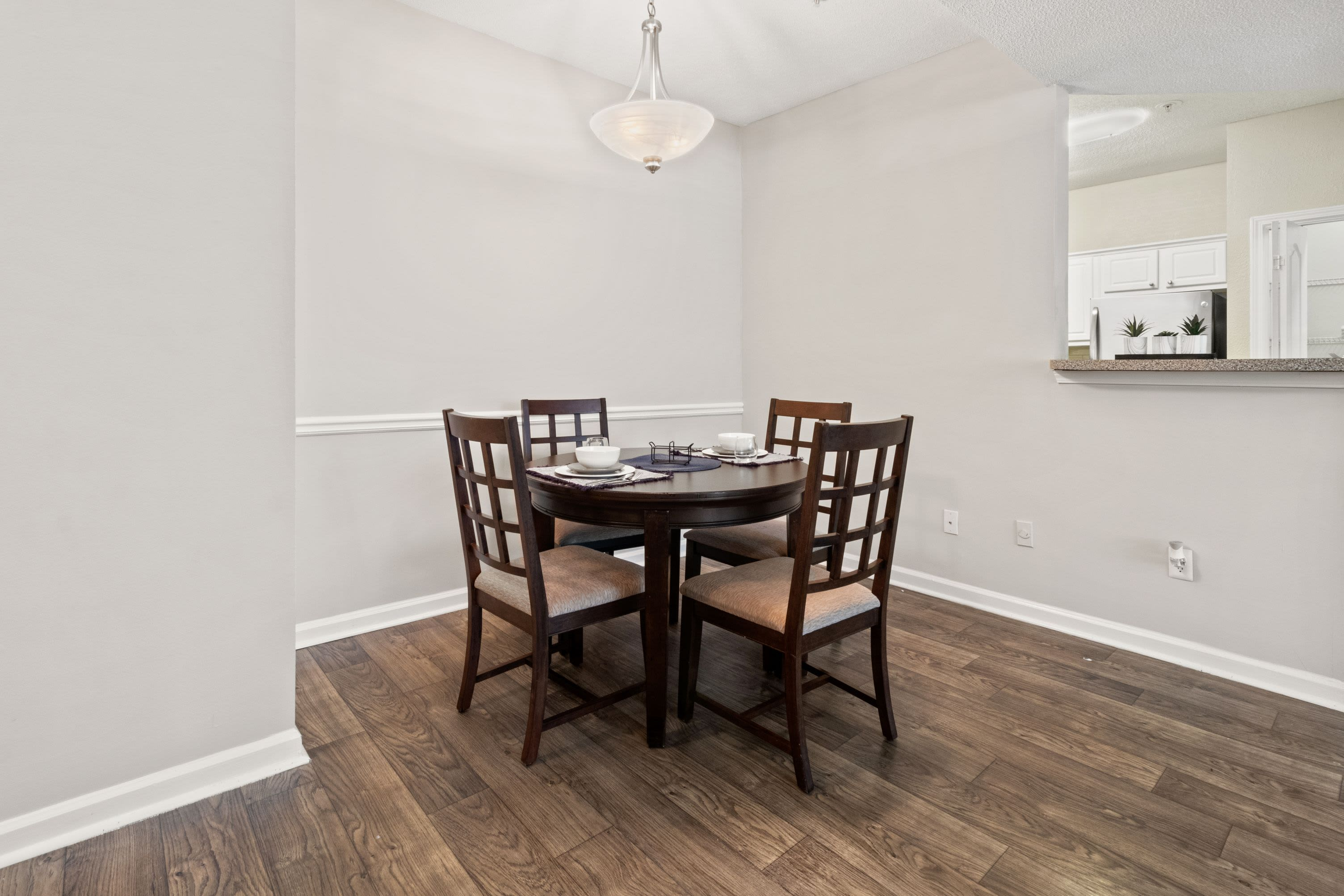 Bright dining room with wood floors at Marquis Midtown West in Atlanta, Georgia
