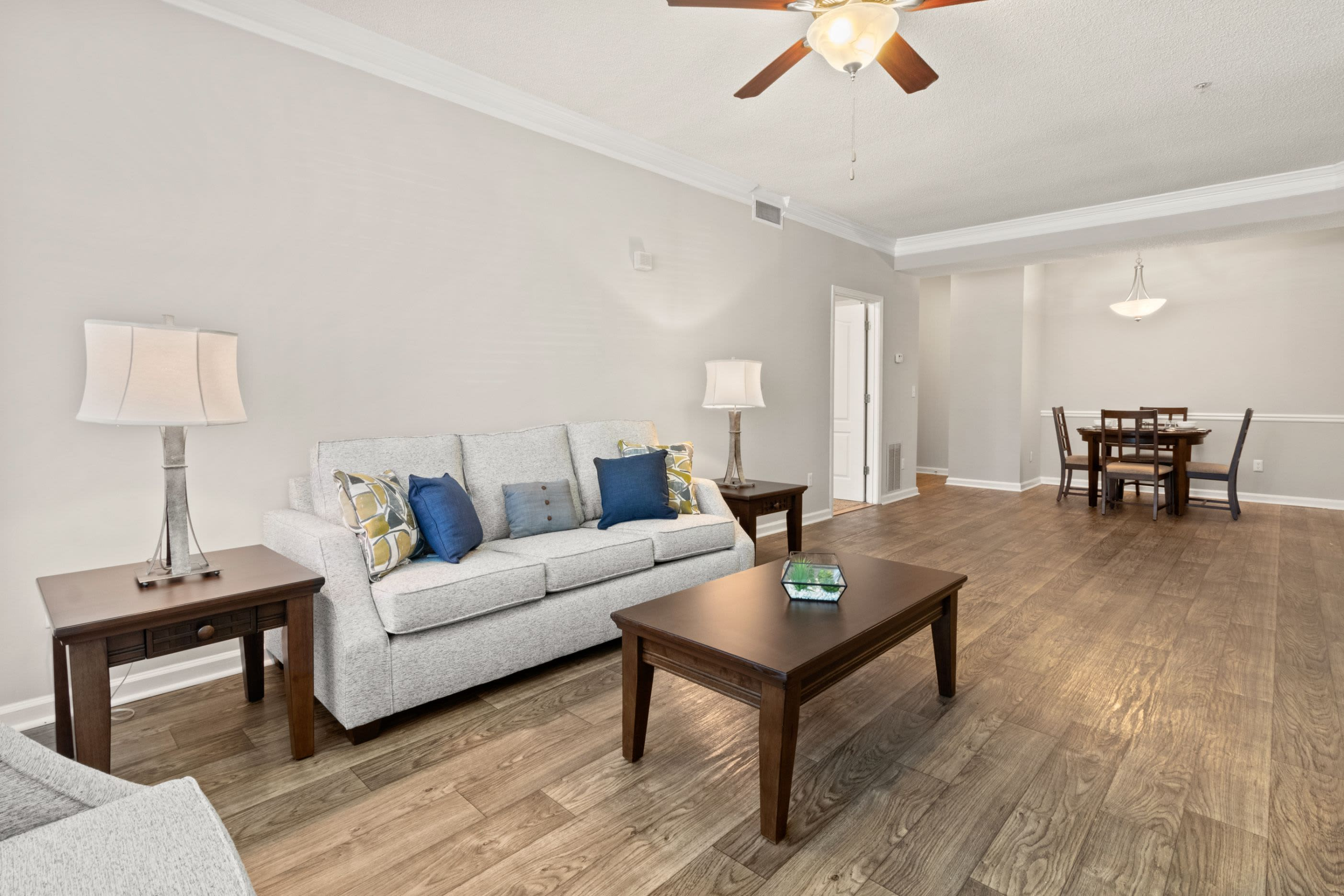 Spacious living room with a ceiling fan at Marquis Midtown West in Atlanta, Georgia