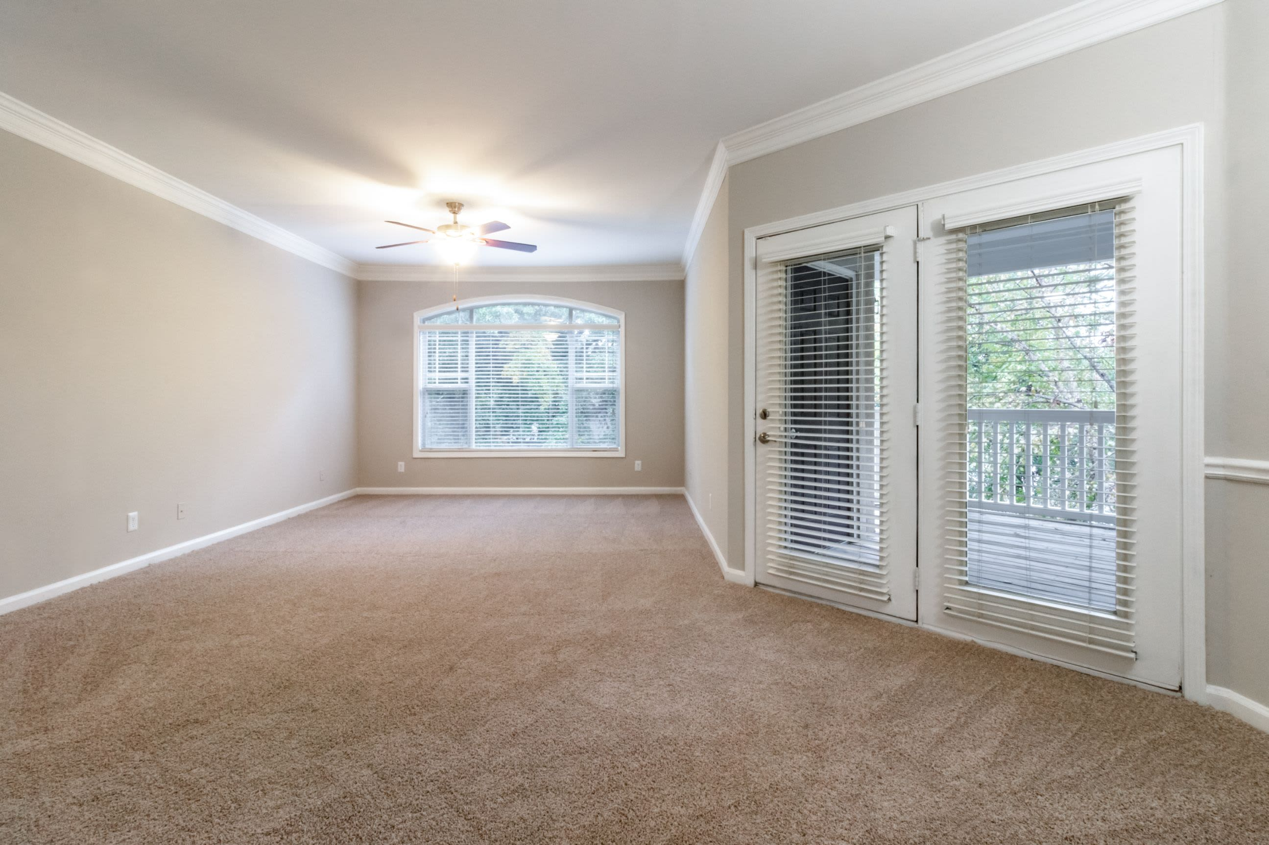 Spacious room with door to private patio at Marquis Midtown West in Atlanta, Georgia