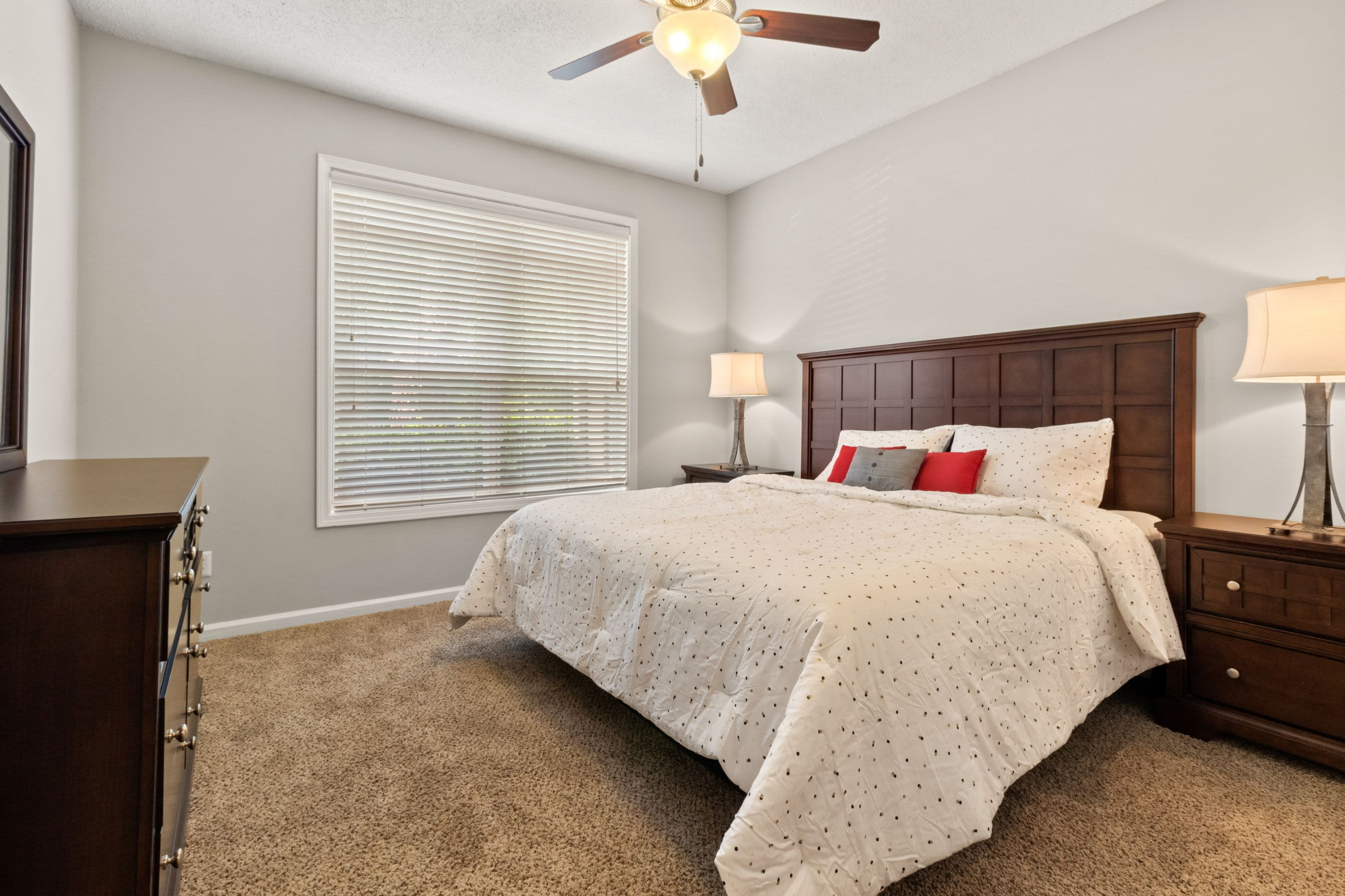 Bedroom with a ceiling fan at Marquis Midtown West in Atlanta, Georgia