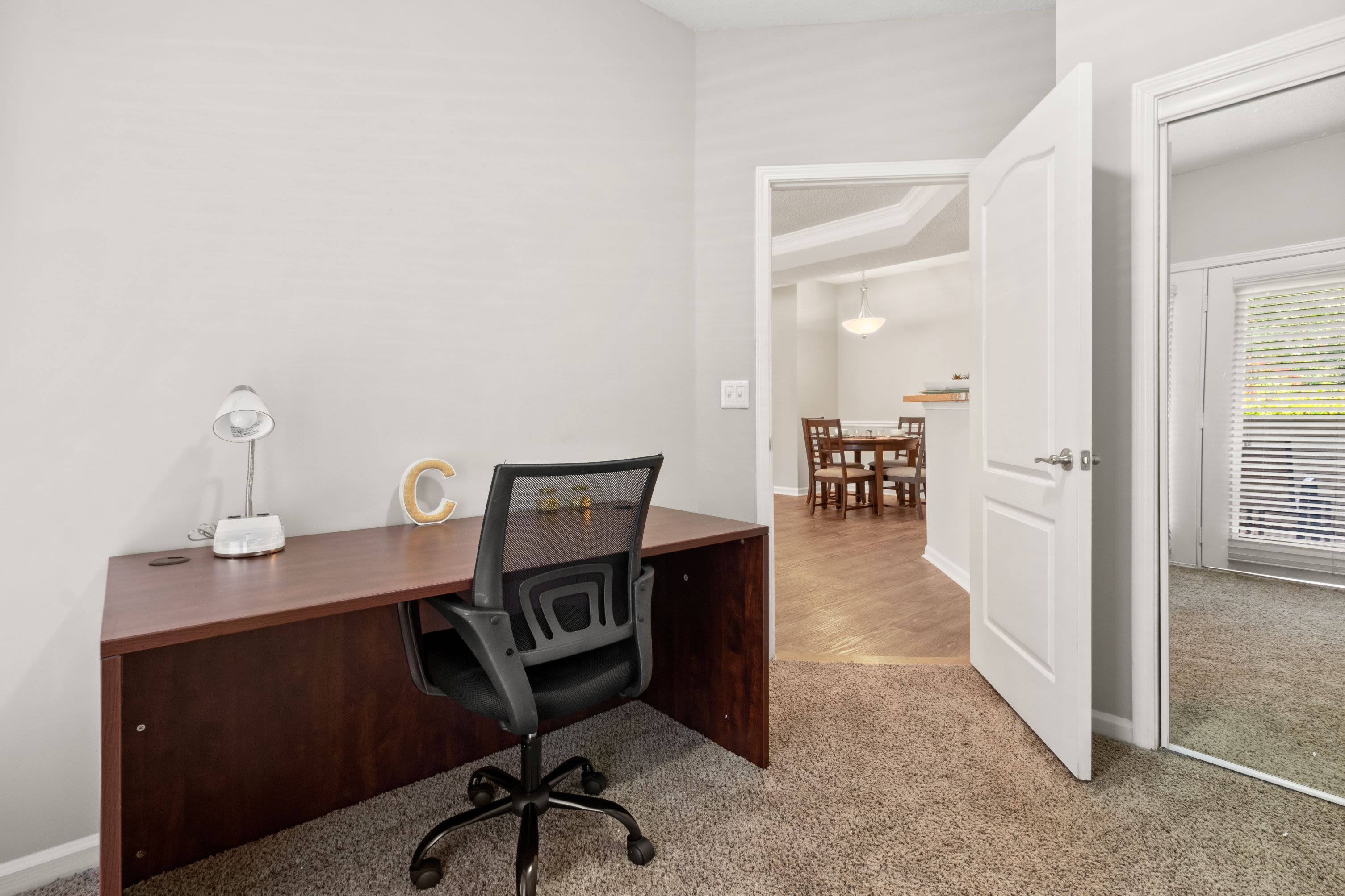 Private workspace with desk and office chair at Marquis Midtown West in Atlanta, Georgia