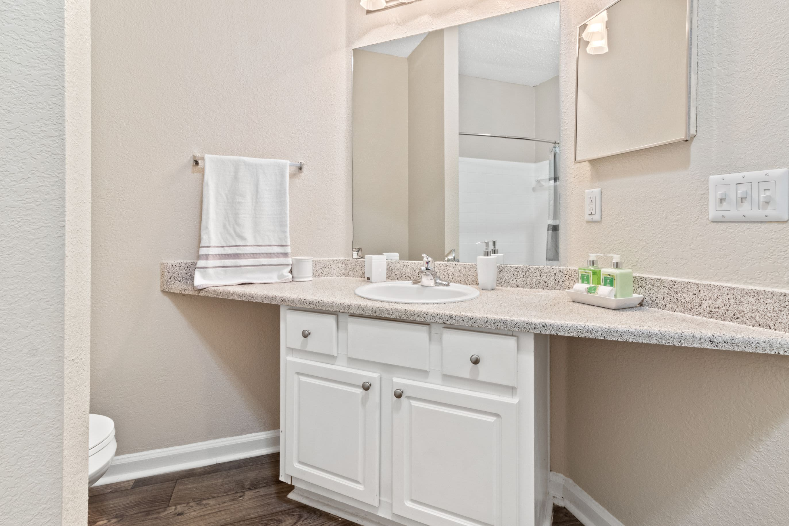 Bathroom with white cabinetry at Marquis Midtown West in Atlanta, Georgia