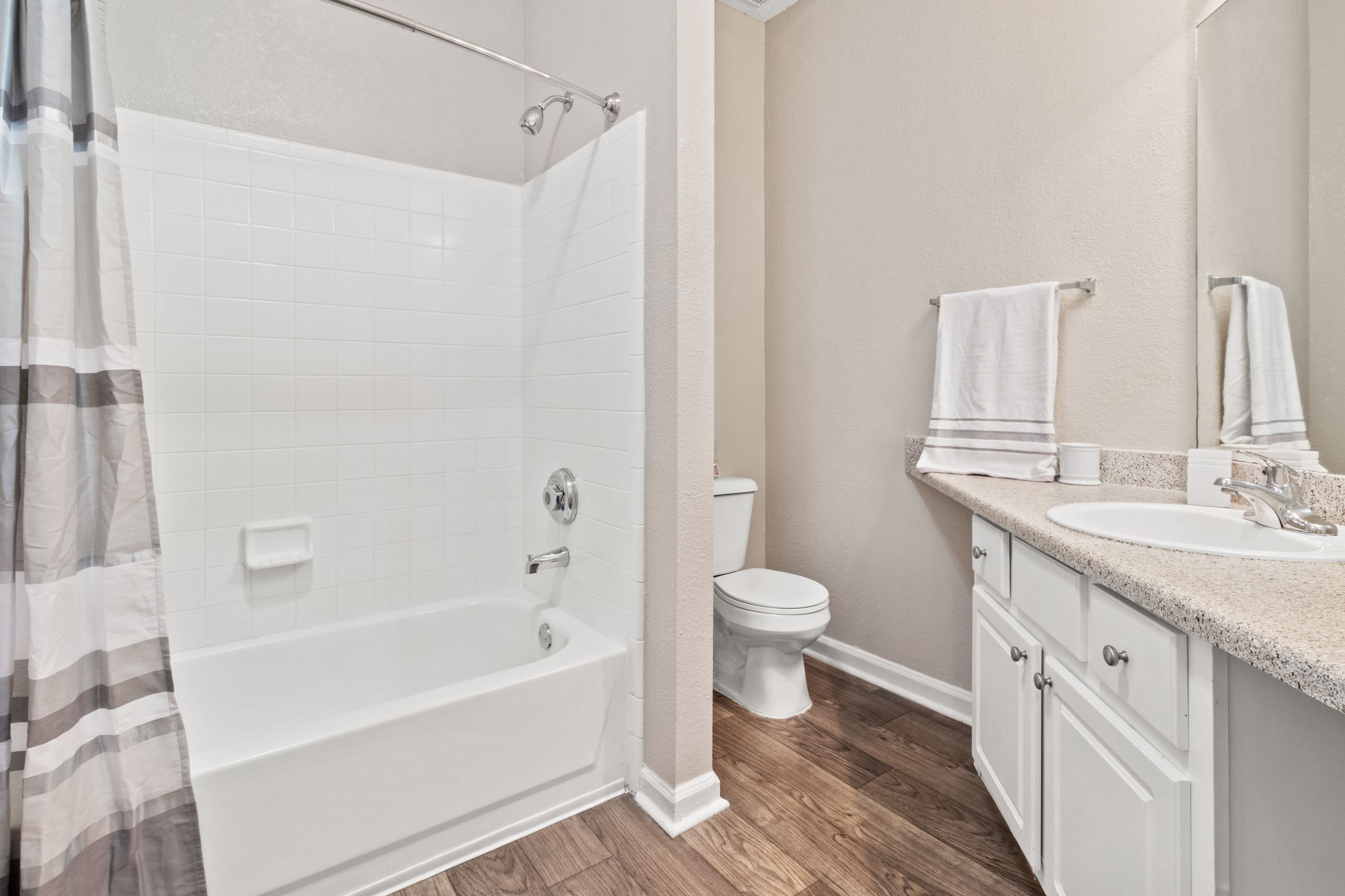 Bathroom with a shower and bathtub at Marquis Midtown West in Atlanta, Georgia