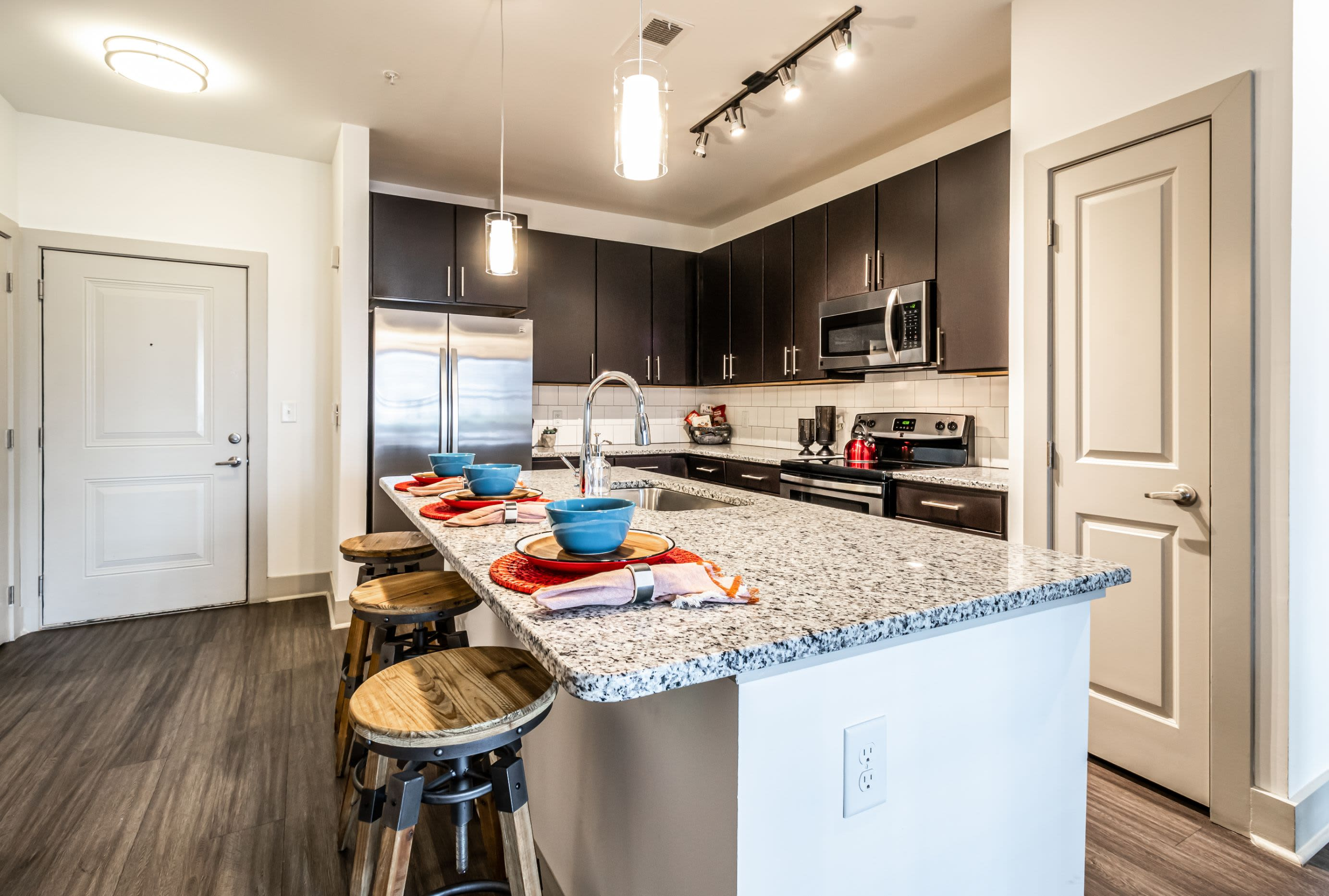 Kitchen with a large island at Skyline West in Atlanta, Georgia