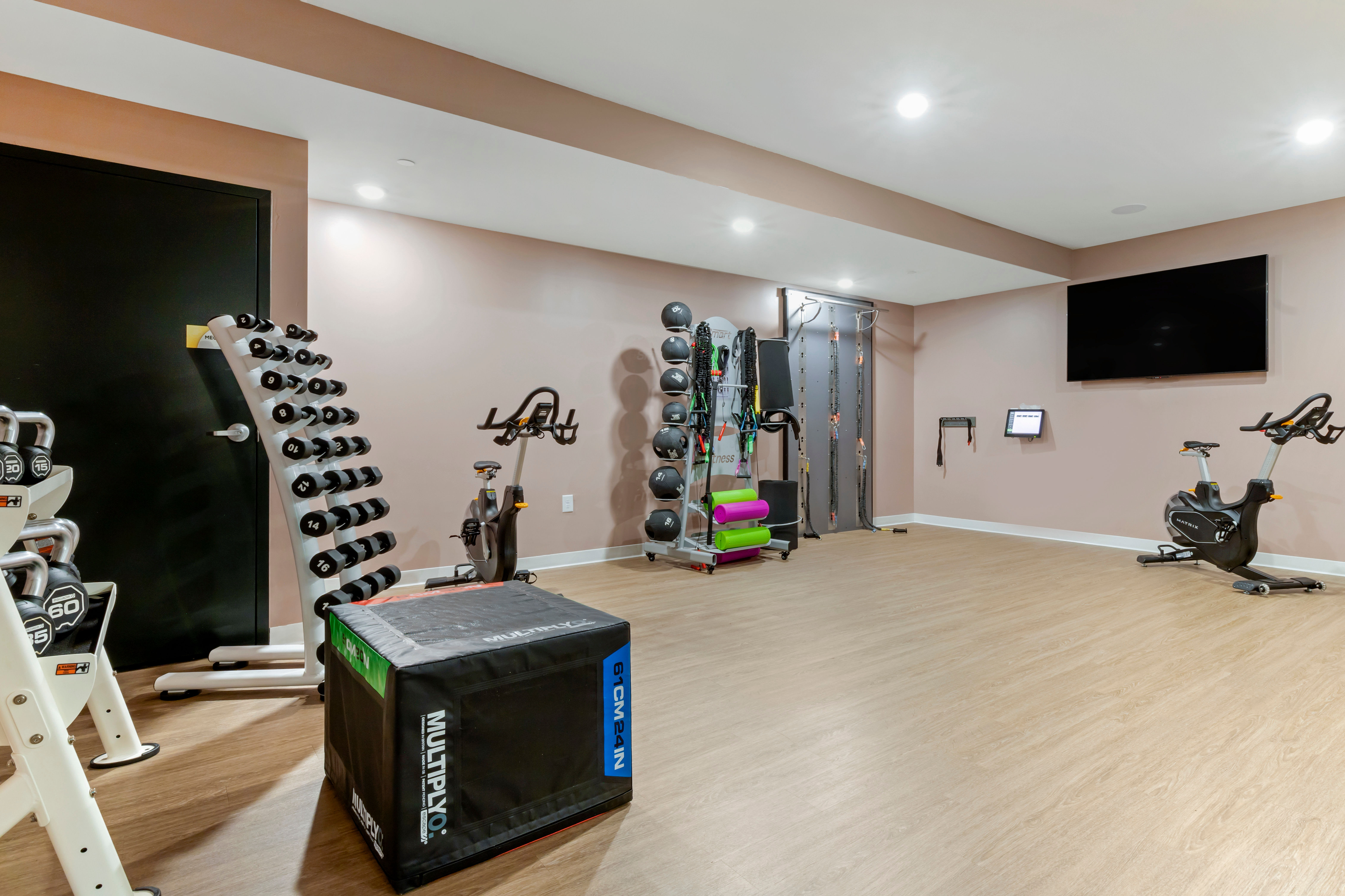 Residents checking out the fitness center at UNCOMMON Raleigh in Raleigh, North Carolina