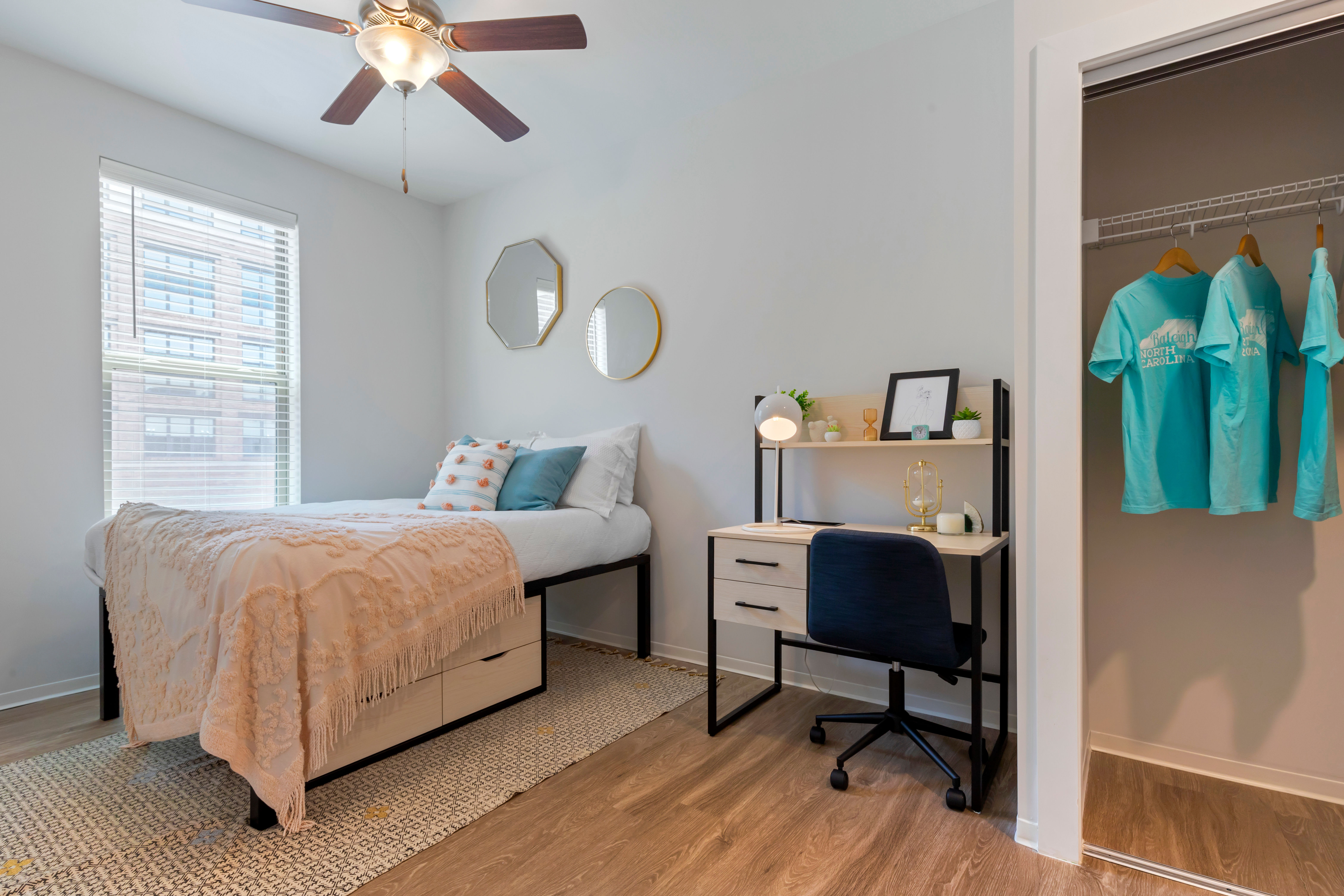 Cozy bedroom at UNCOMMON Raleigh in Raleigh, North Carolina
