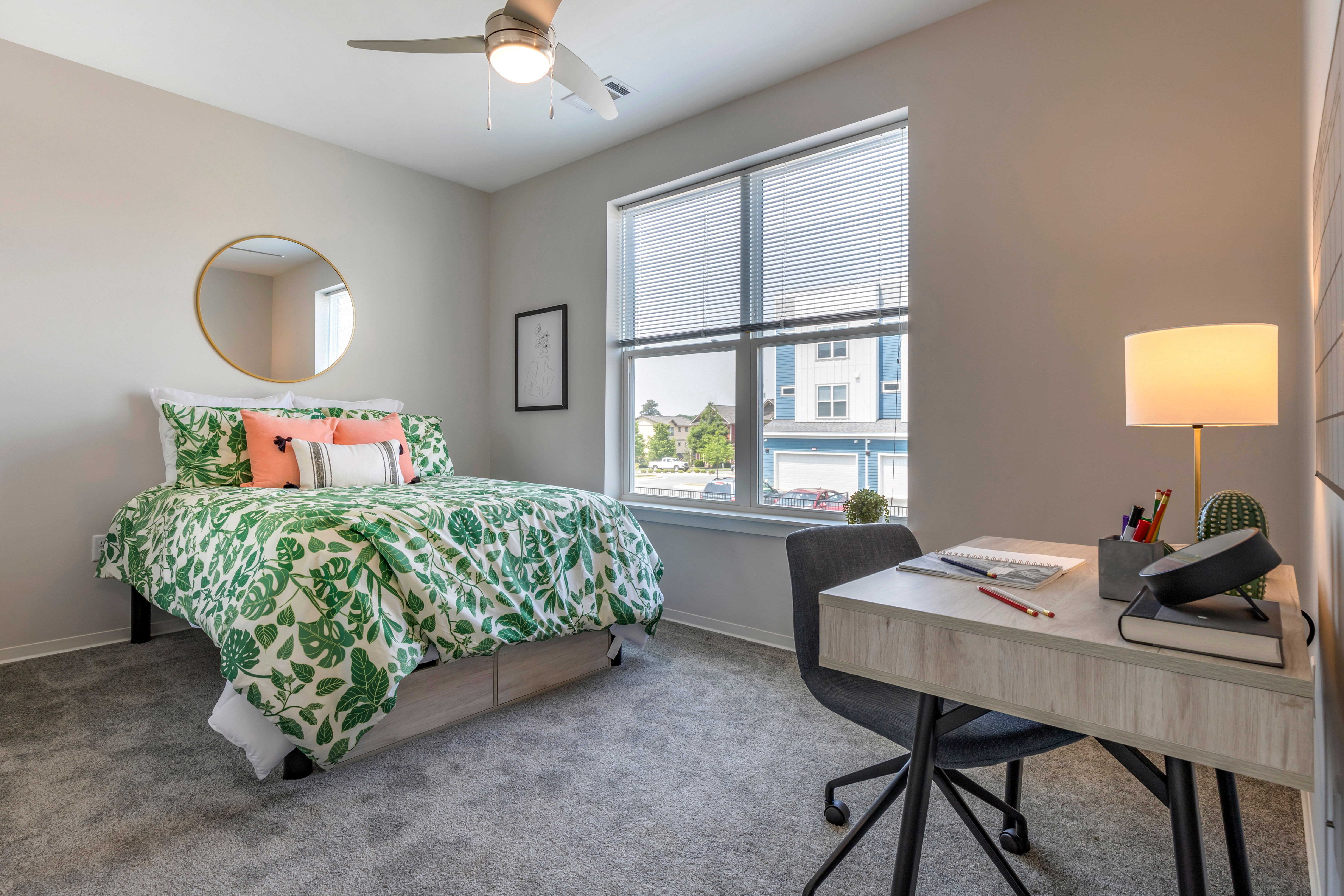 Well decorated bedroom at LATITUDE on Hillsborough in Raleigh, North Carolina