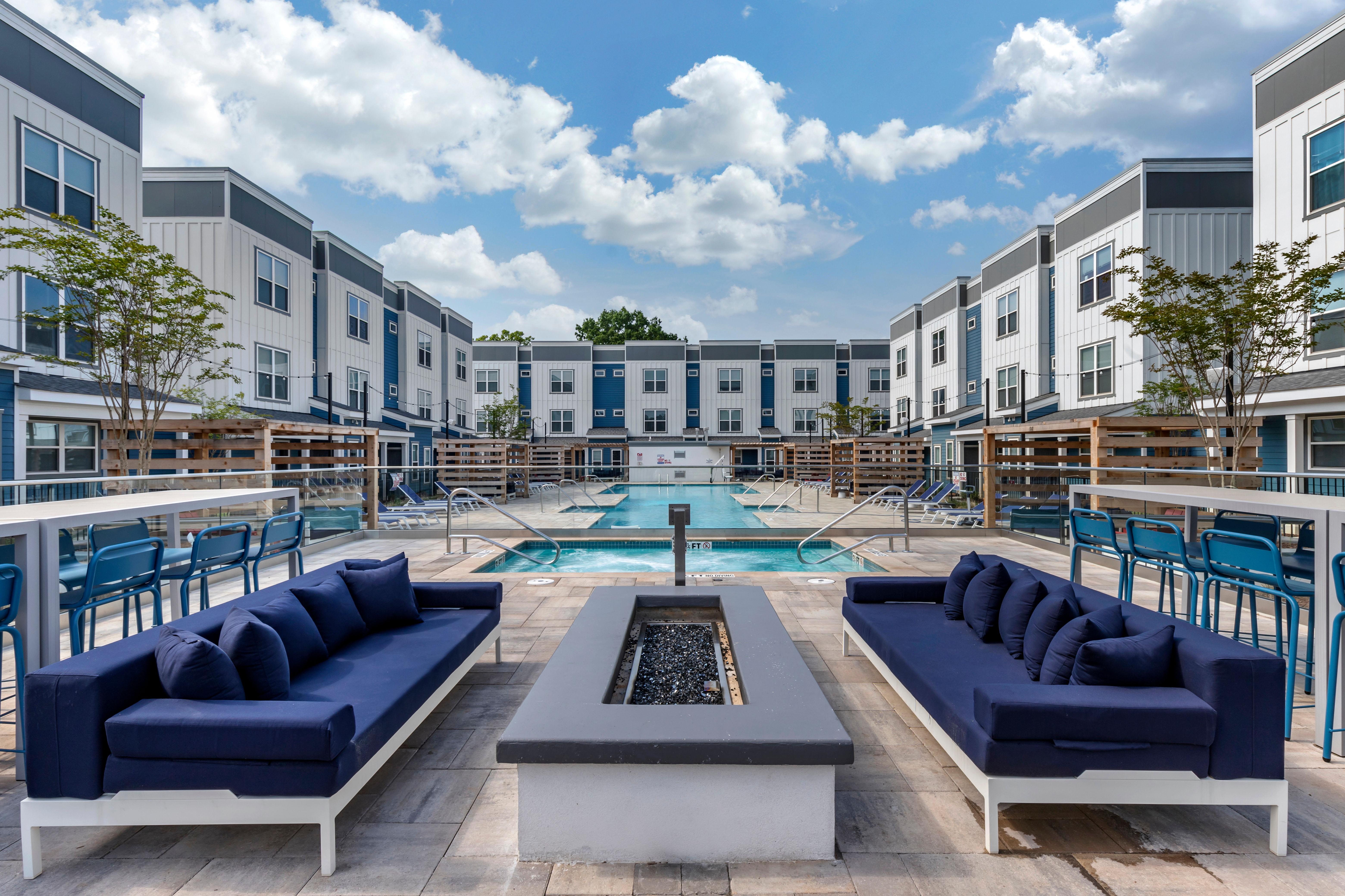 Resort-style swimming pool lounge seating at LATITUDE on Hillsborough in Raleigh, North Carolina