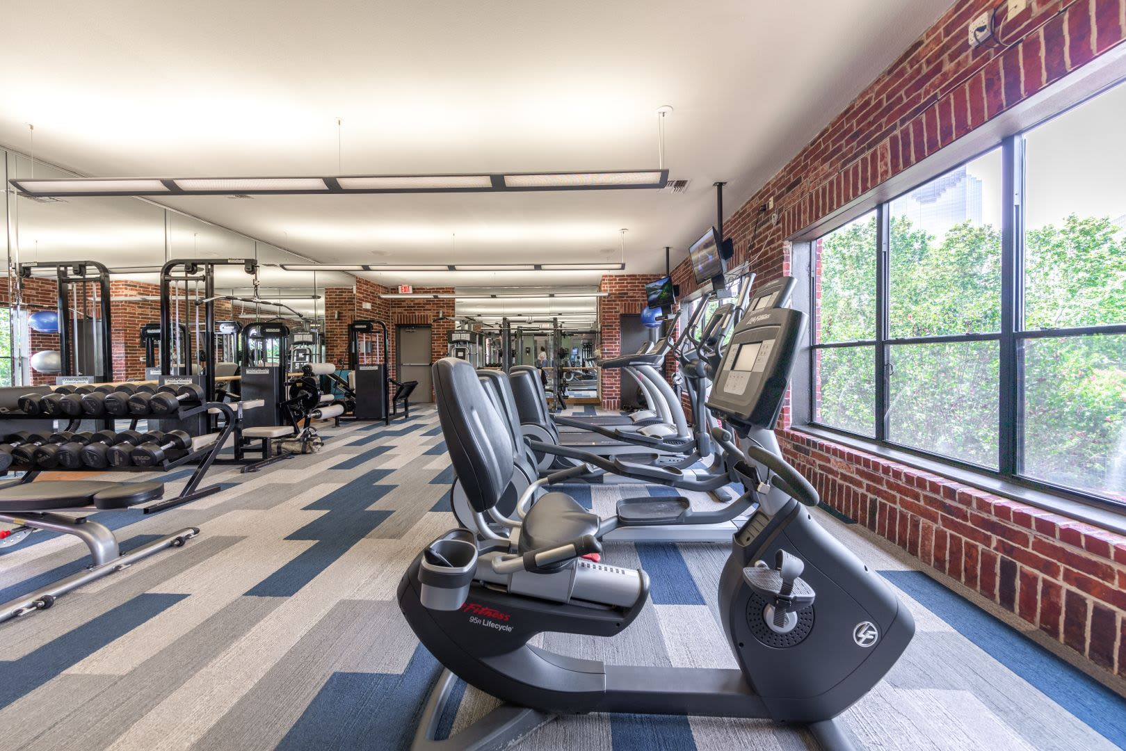 Fully equipped fitness center at Marquis Lofts on Sabine in Houston, Texas