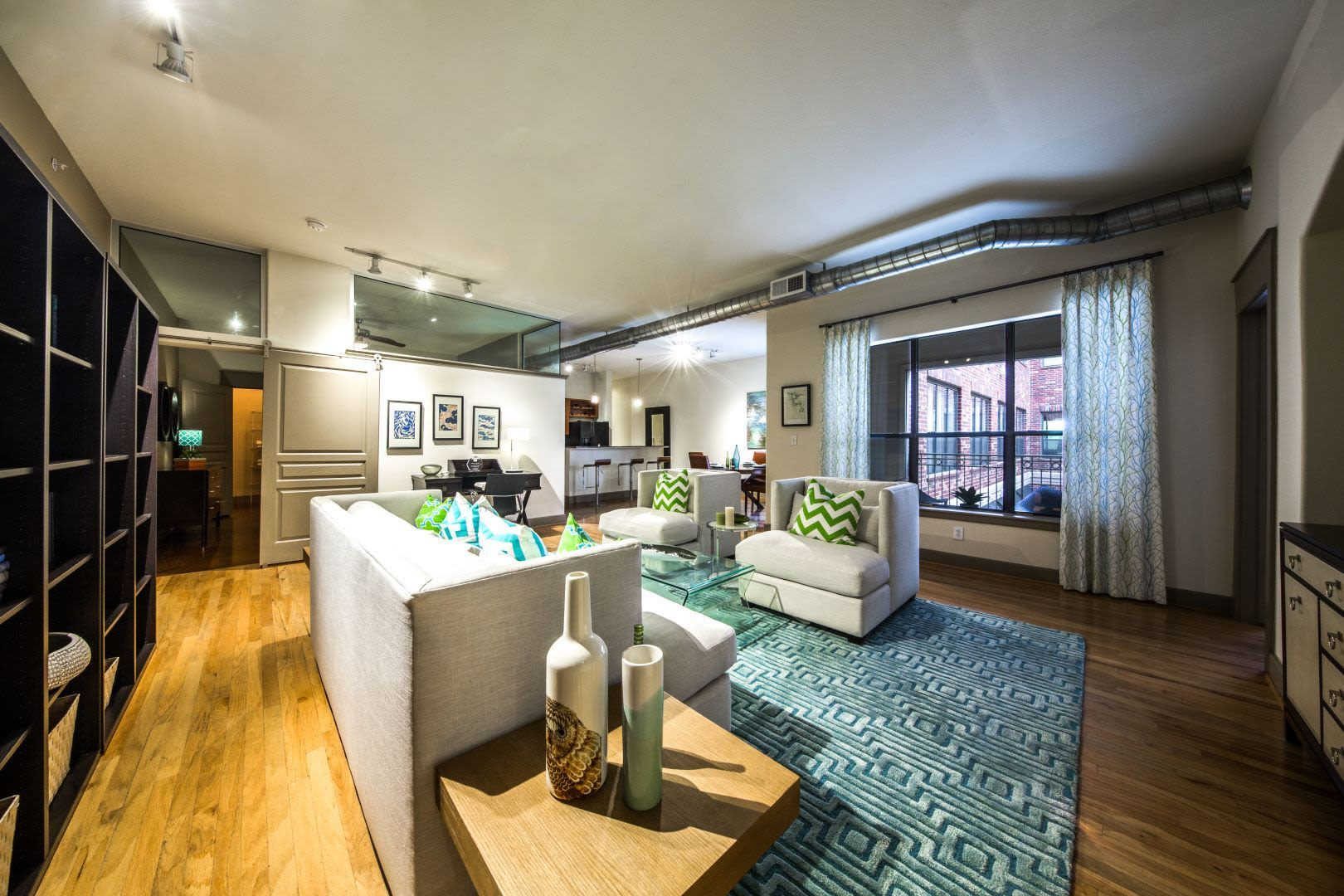 Bright and spacious living area at Marquis Lofts on Sabine in Houston, Texas