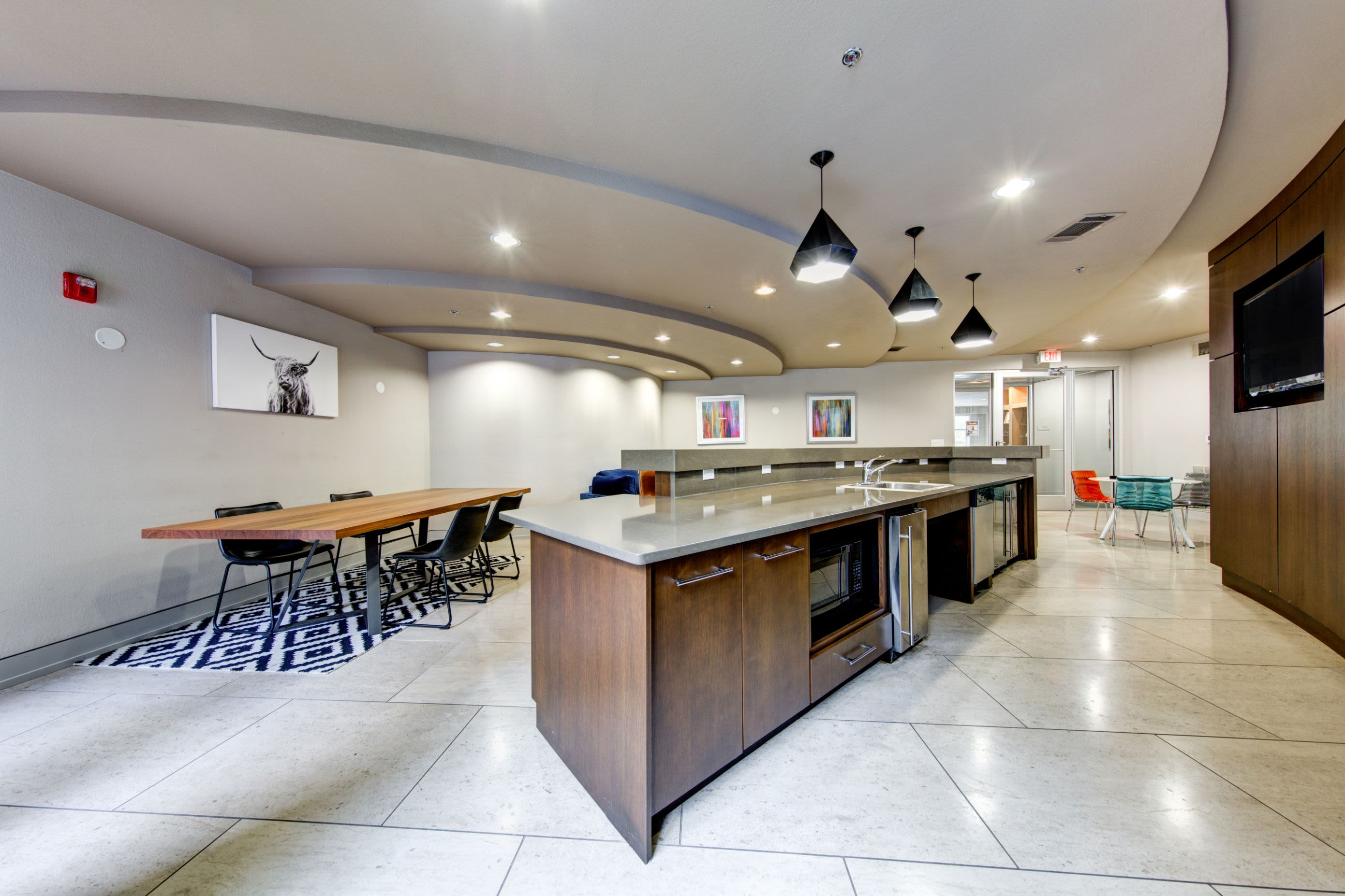 Kitchenette in community clubhouse at The Marq on West 7th in Fort Worth, Texas