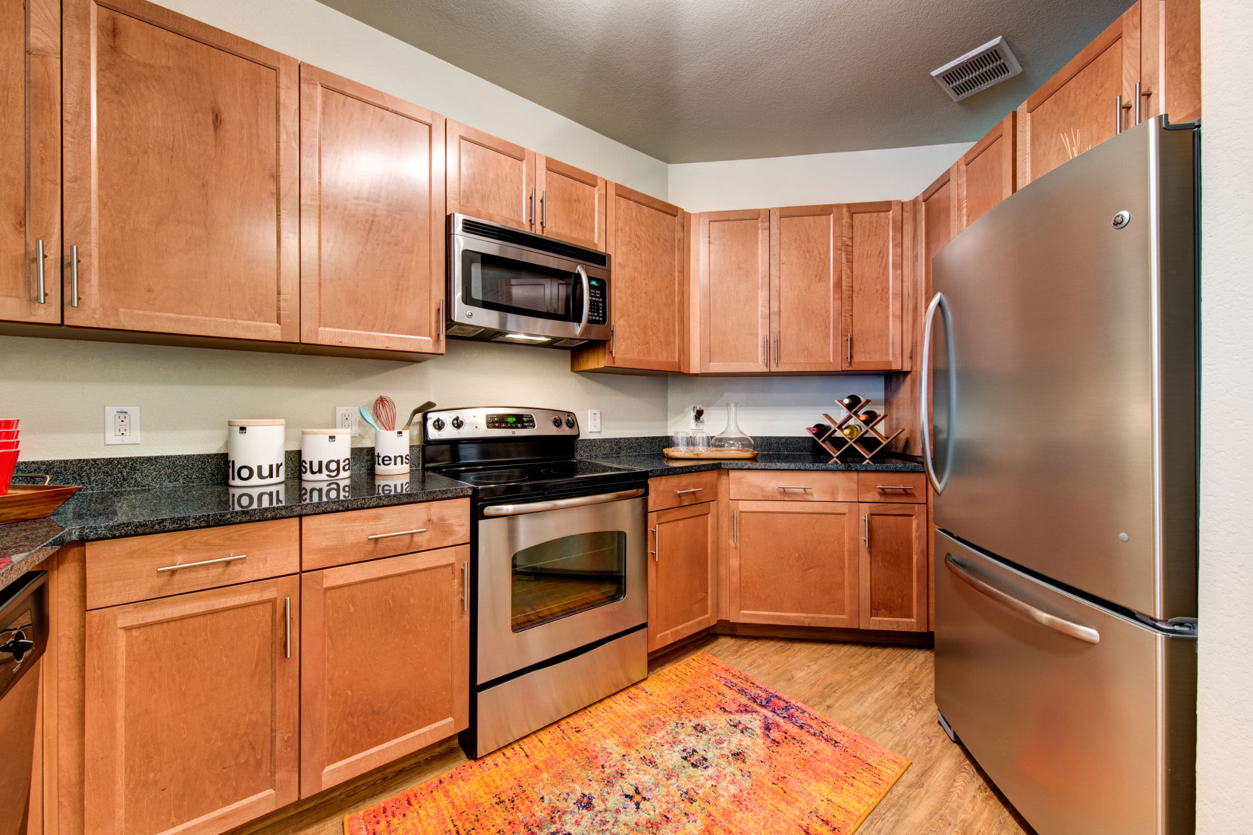 Kitchen with stainless steel appliances at The Marq on West 7th in Fort Worth, Texas