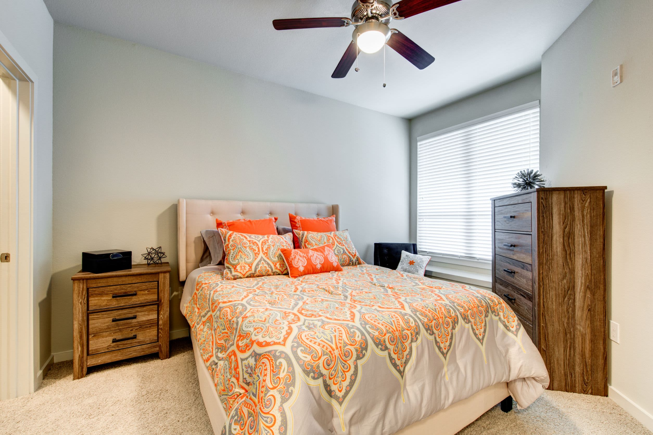 Spacious bedroom with a ceiling fan at The Marq on West 7th in Fort Worth, Texas
