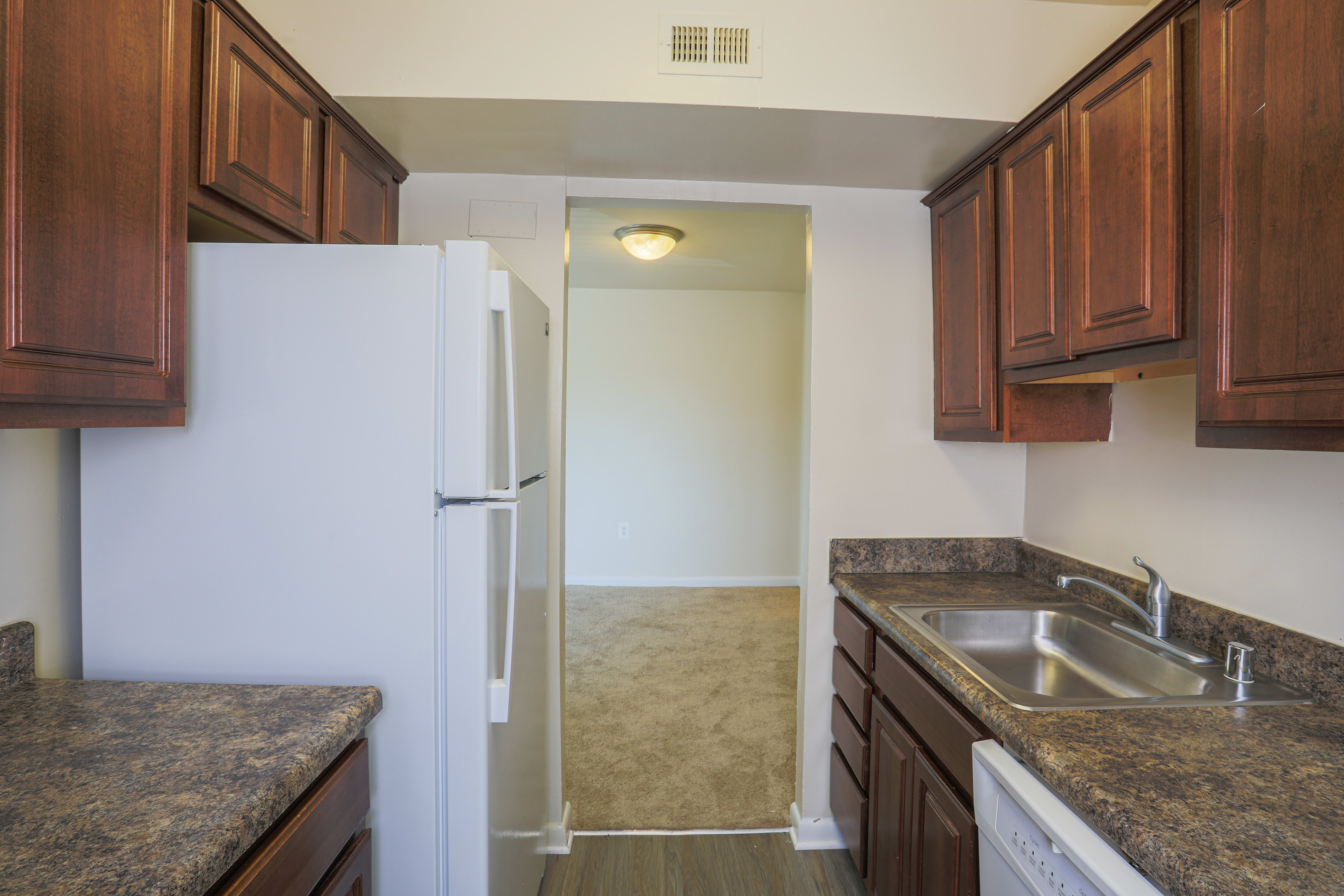 Kitchen with wood cabinest in Regency Pointe