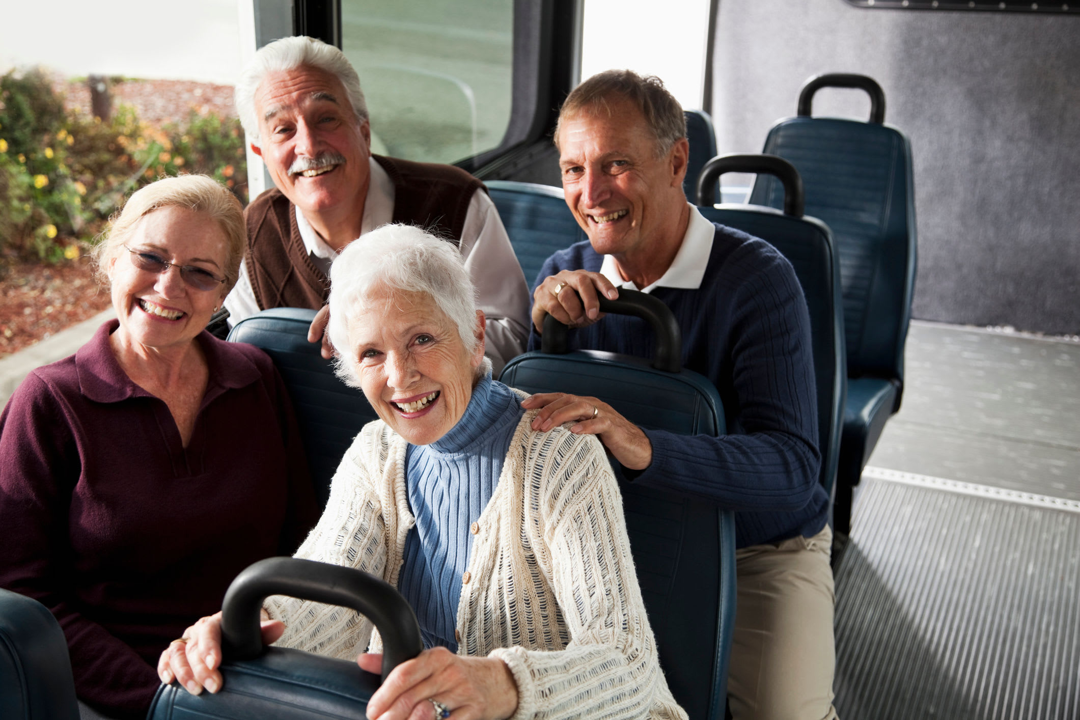 Residents smiling on the group transportation bus at The Springs at Sunnyview in Salem, Oregon