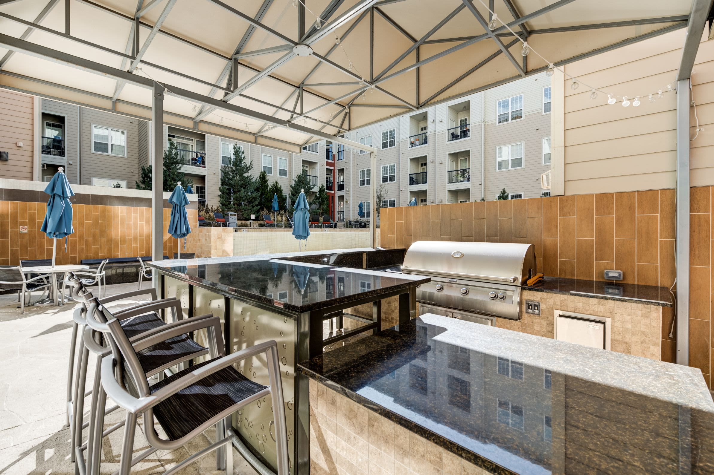 Outdoor community lounge with grills at The Marq at Ridgegate in Lone Tree, Colorado