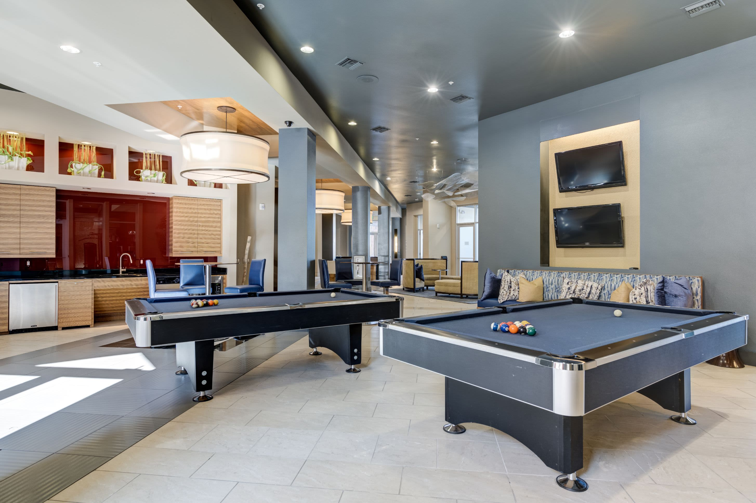 Clubhouse with pool tables and a kitchen at The Marq at Ridgegate in Lone Tree, Colorado
