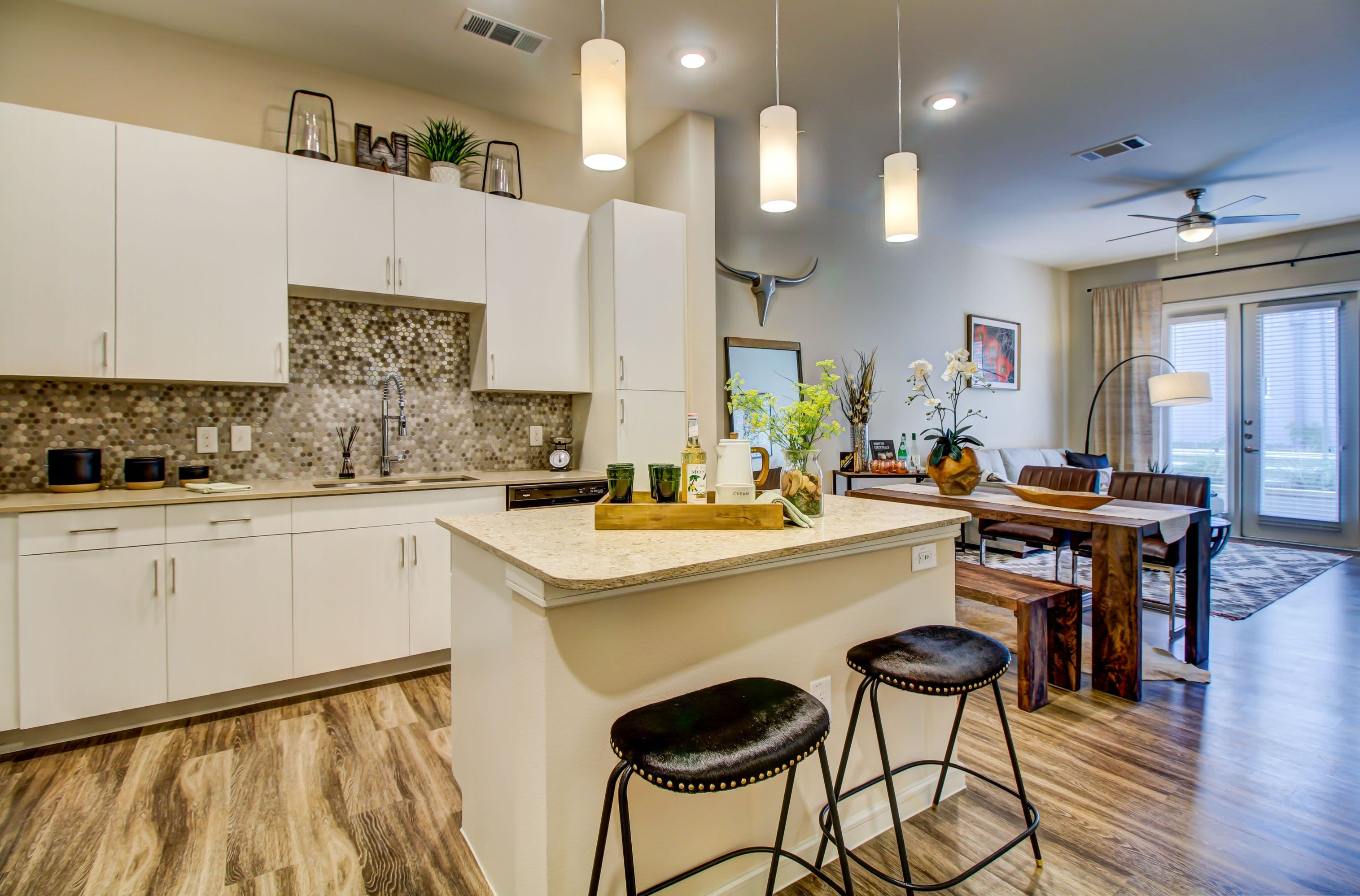 Bright kitchen with modern finishes at Westerly 360 in Austin, Texas