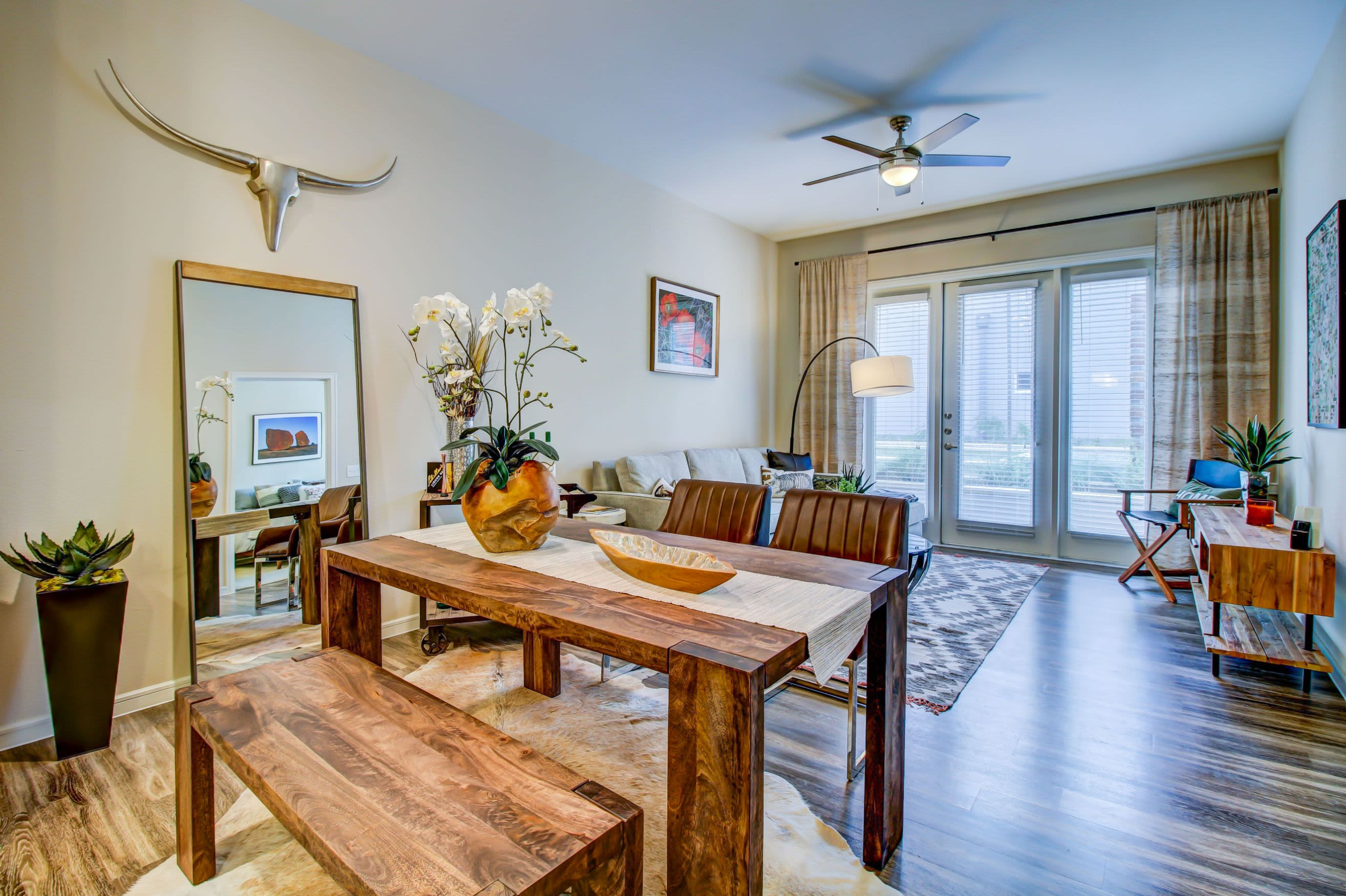 Open dining area with wood floors at Westerly 360 in Austin, Texas