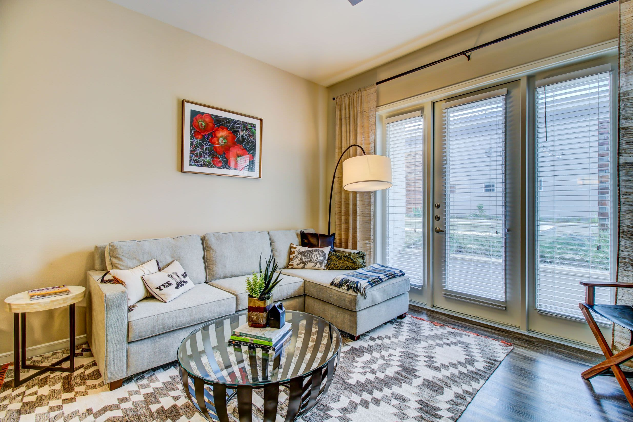 Spacious living room with French doors at Westerly 360 in Austin, Texas