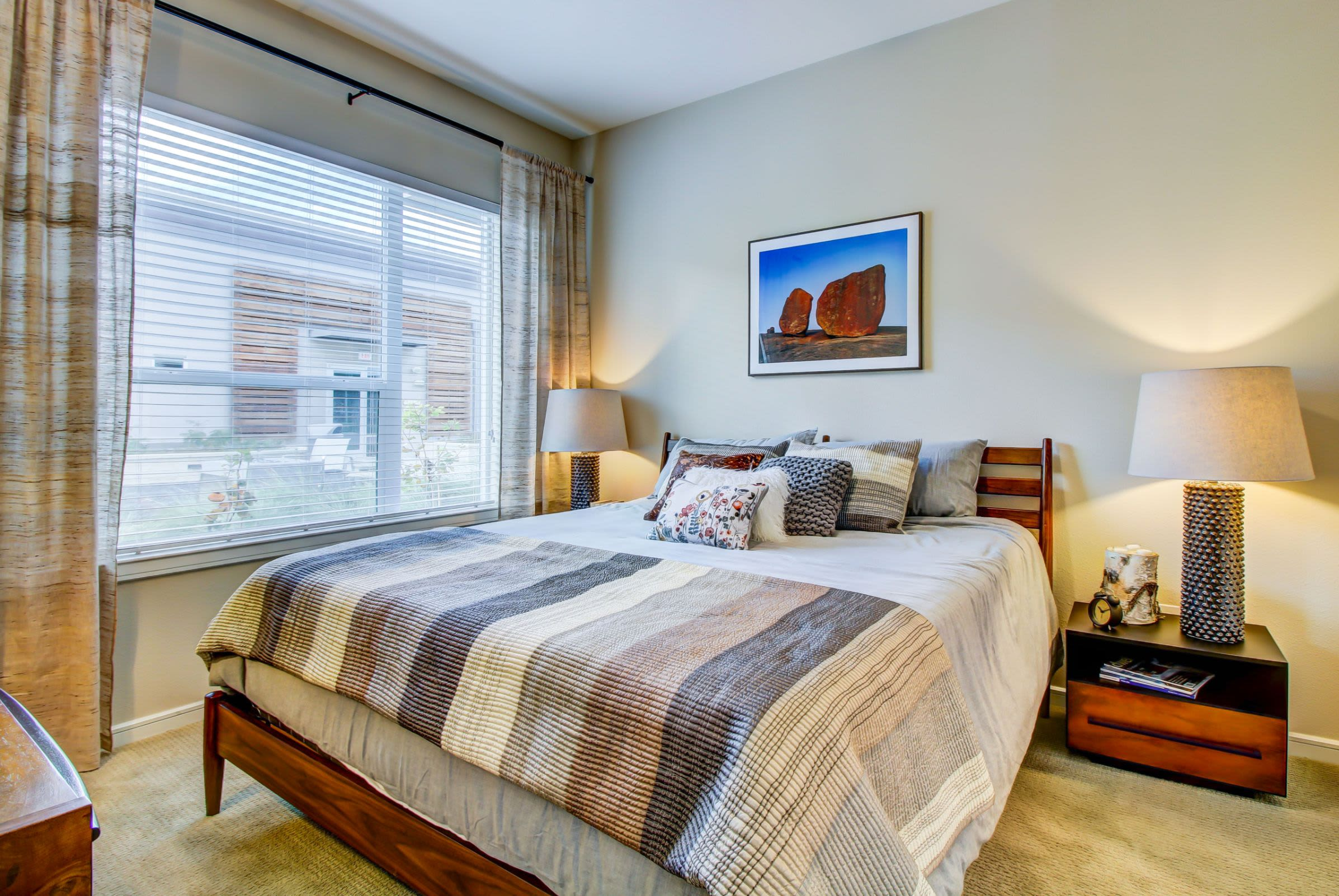 Bright bedroom with a large window at Westerly 360 in Austin, Texas