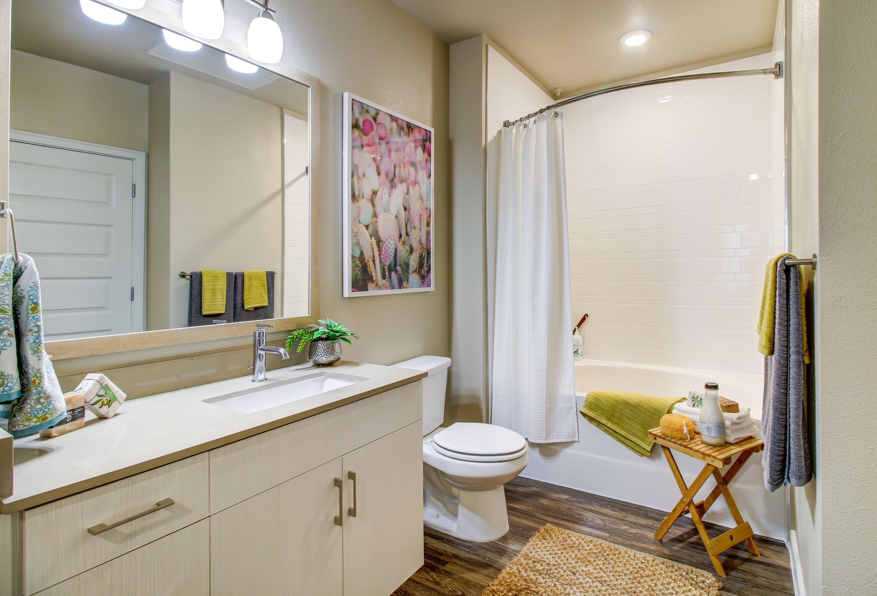 Bright bathroom with white cabinets at Westerly 360 in Austin, Texas