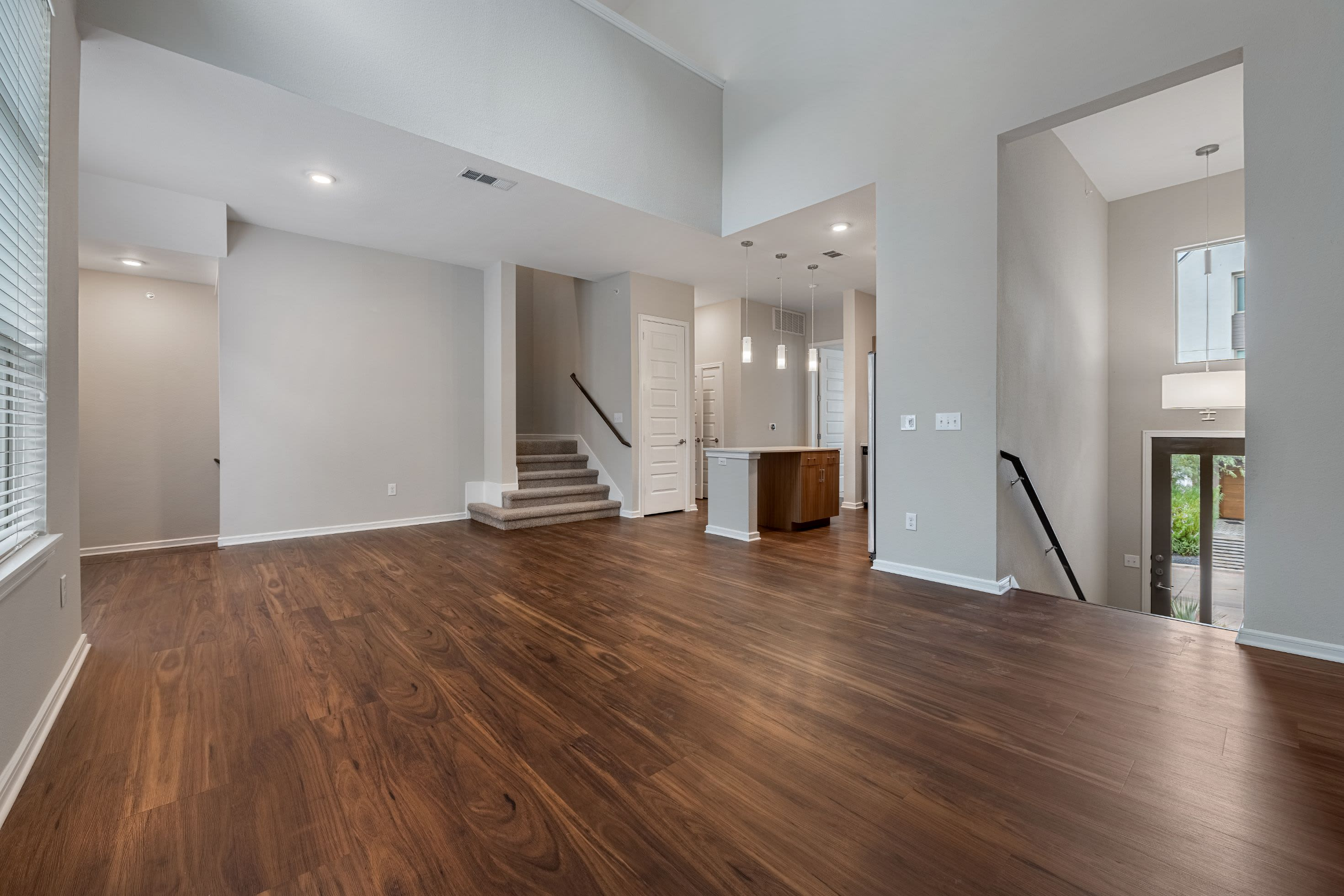 Living area with 2 staircases at Westerly 360 in Austin, Texas