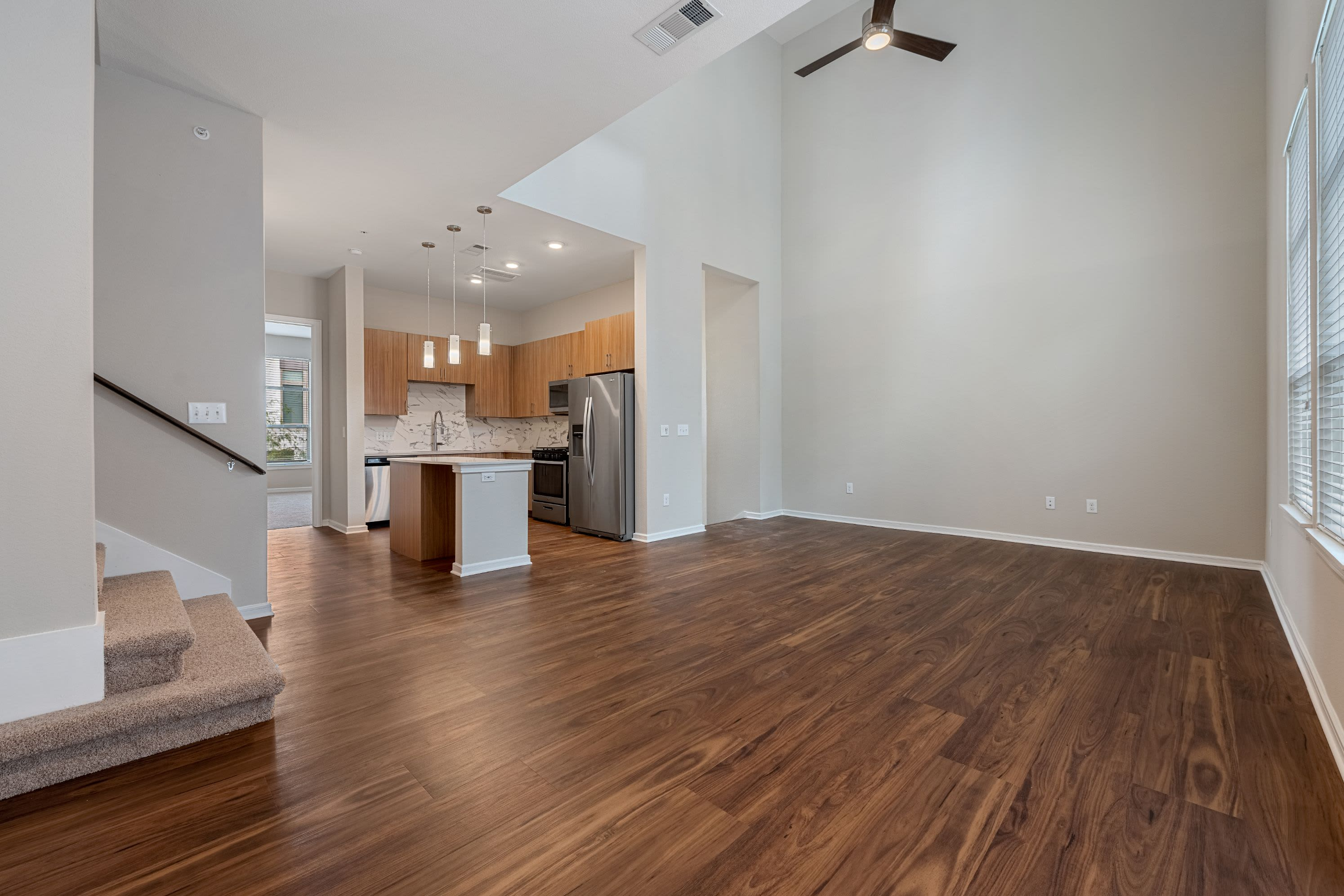 Spacious living room with wood floors at Westerly 360 in Austin, Texas