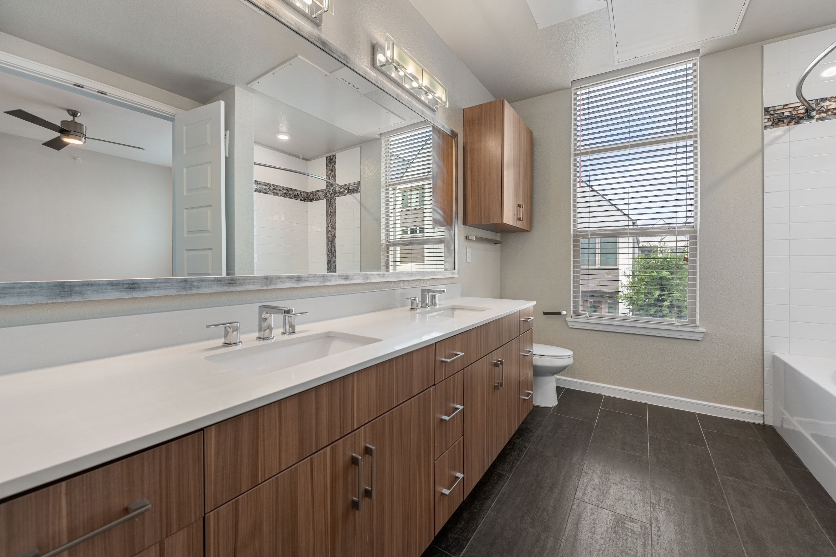 Large bathroom with double sinks at Westerly 360 in Austin, Texas