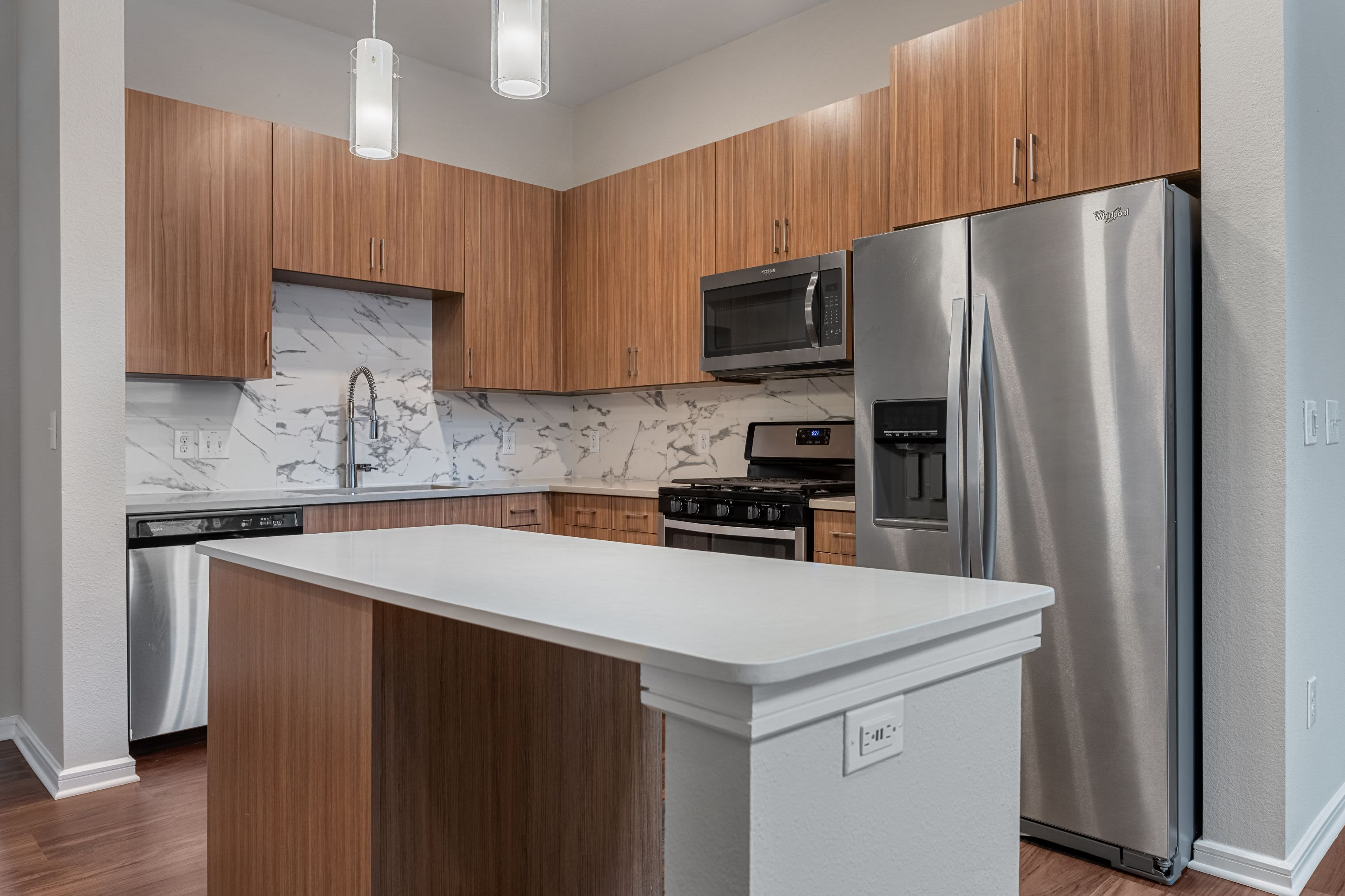 Modern kitchen with an island at Westerly 360 in Austin, Texas